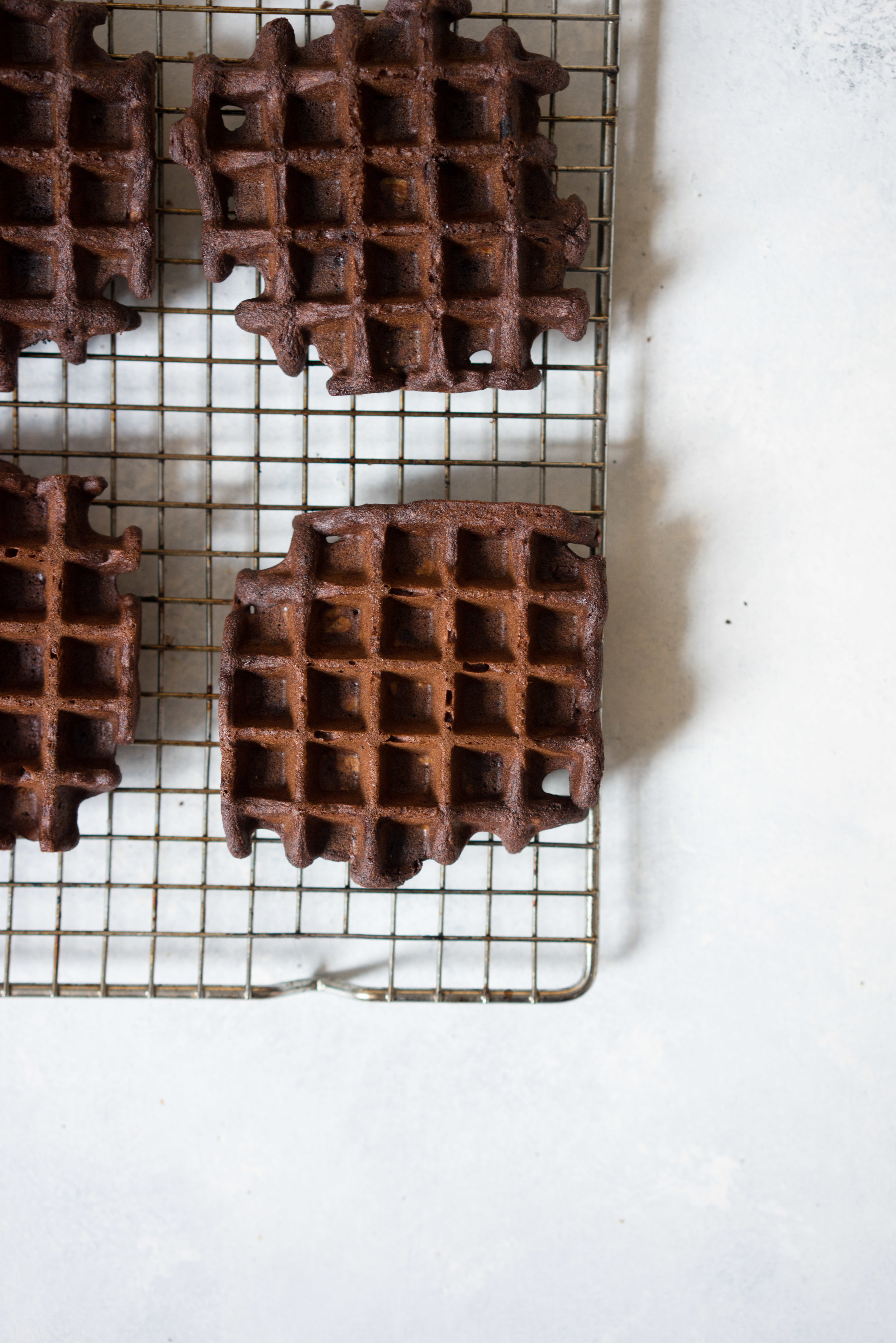 Gluten free chocolate chestnut waffles with coconut yoghurt and maple syrup