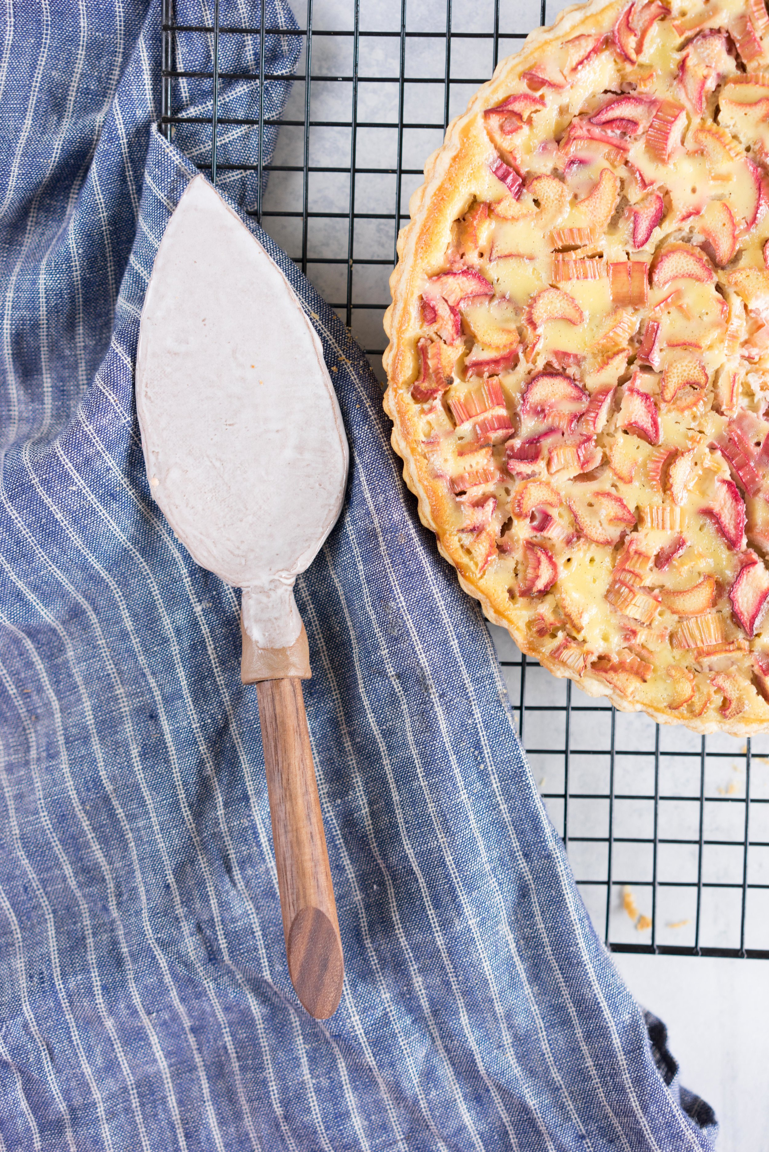 Rhubarb flan - flaky pastry and thinly sliced rhubarb encased in a creamy vanilla custard
