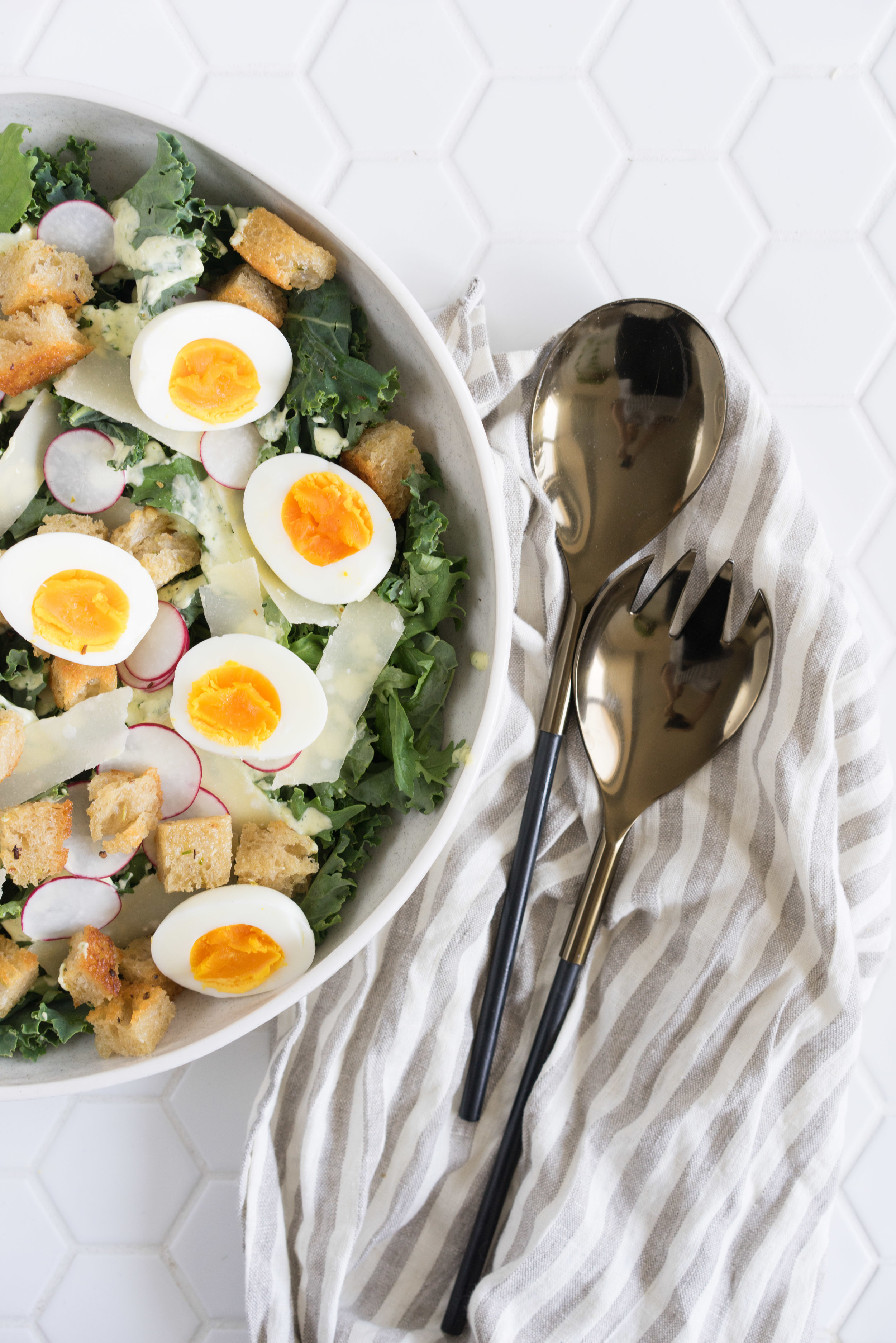 Kale Caesar salad with green garlic croutons and chive caesar dressing