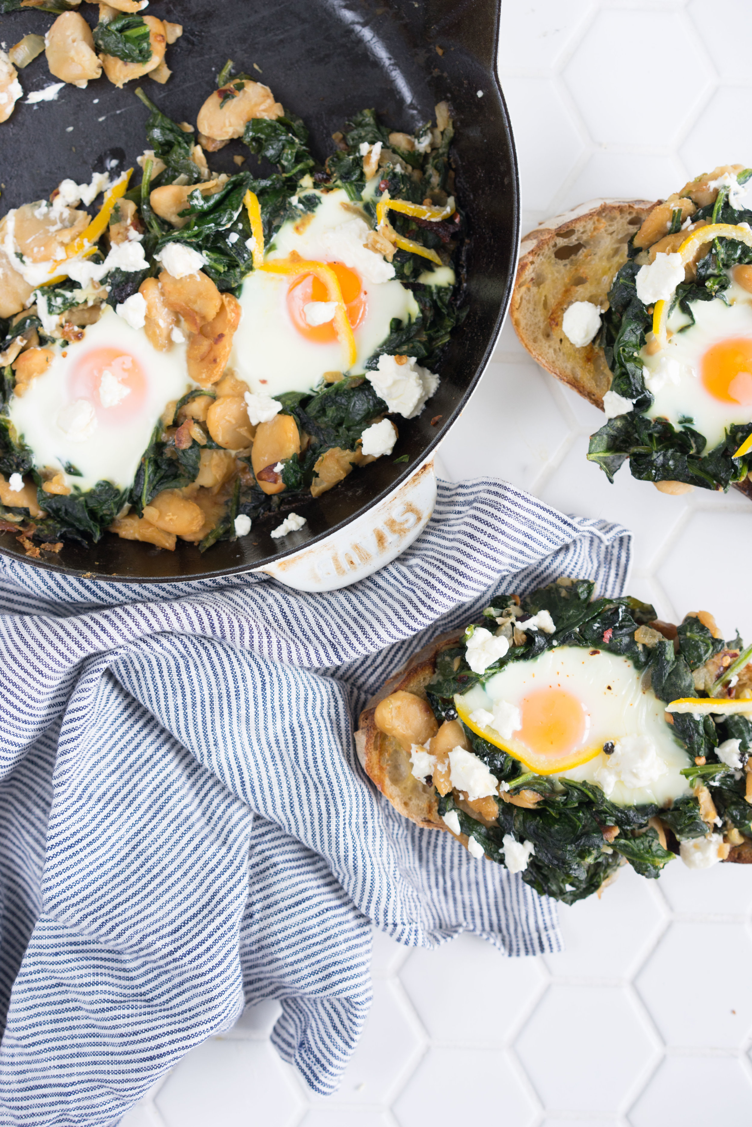 spinach and butter bean baked eggs with feta and preserved lemon