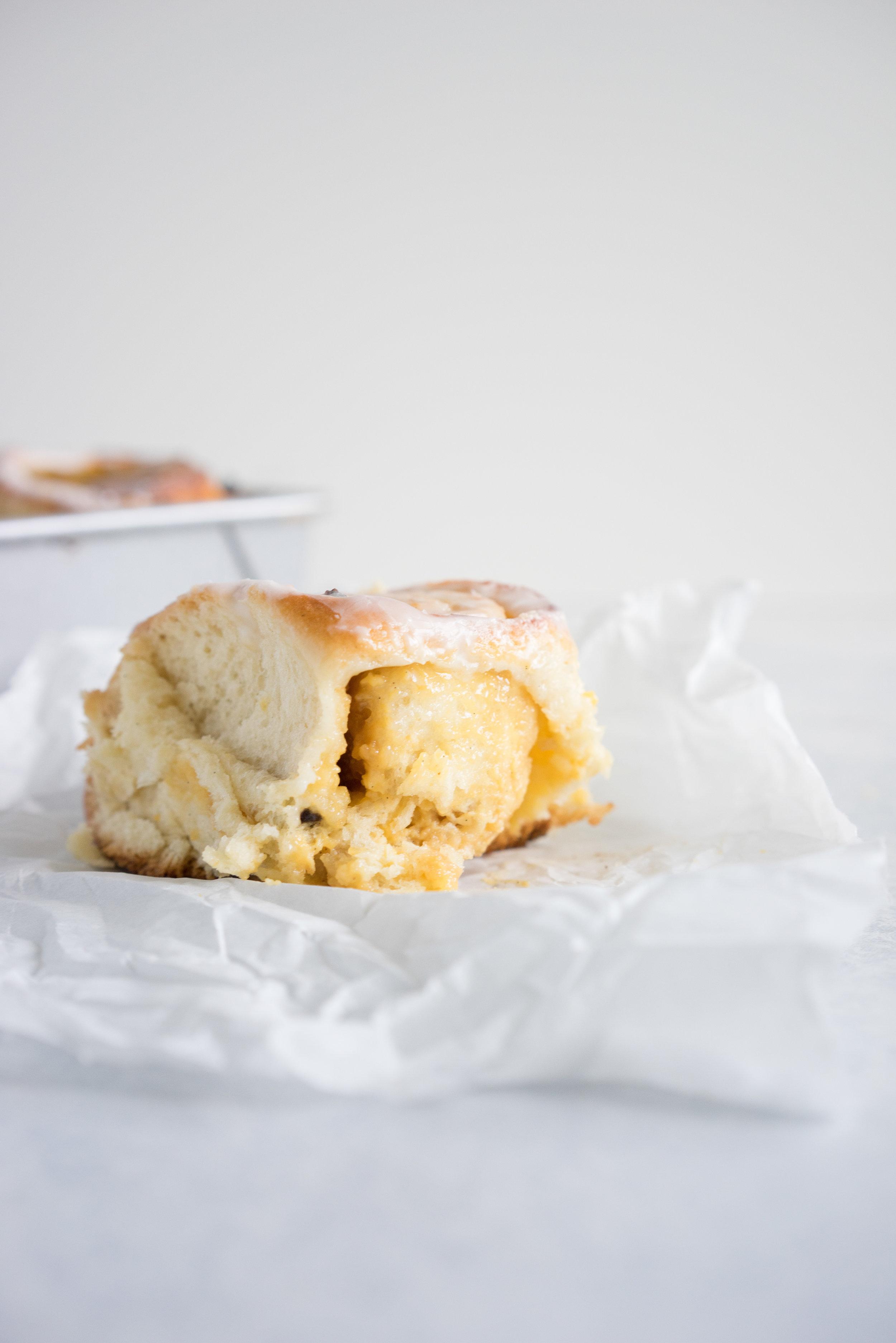 Chelsea buns (custard and raisin brioche buns), by Cloudy Kitchen. Fluffy brioche filled with a vanilla custard and raisins. An amazing riff on the traditional cinnamon bun. #chelseabun #custardbun #custardandraisin #brioche #vanillafrosting #custardscroll