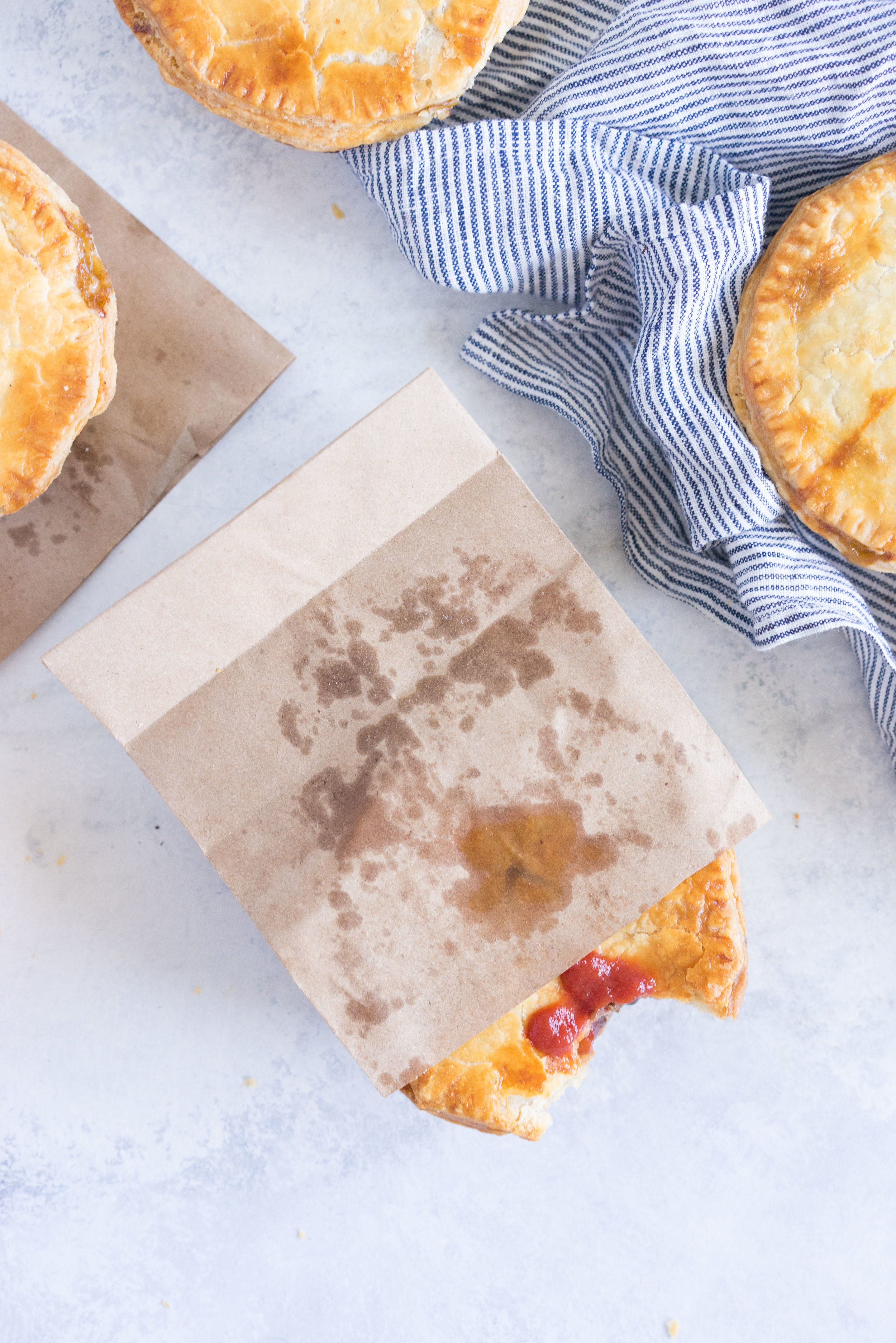 Individual steak and mushroom pies - flaky pastry encases a rich meaty filling with a flavourful gravy
