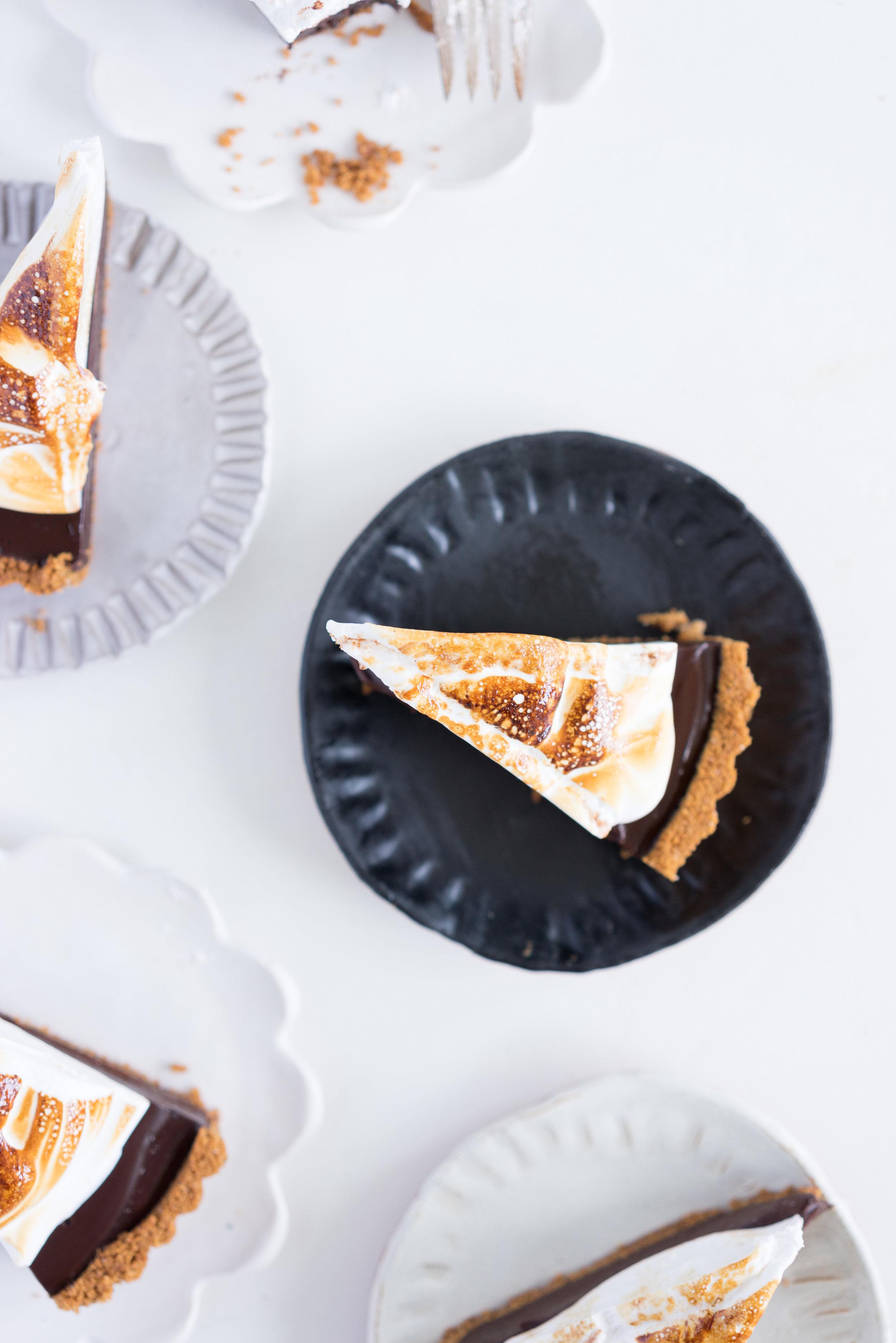 S'mores tart - brown butter graham cracker crust, silky chocolate ganache filling, and toasty vanilla bean marshmallow. #tart #chocolatetart #s'morestart #grahamcracker #smorestart #brownbutter #chocolateganache