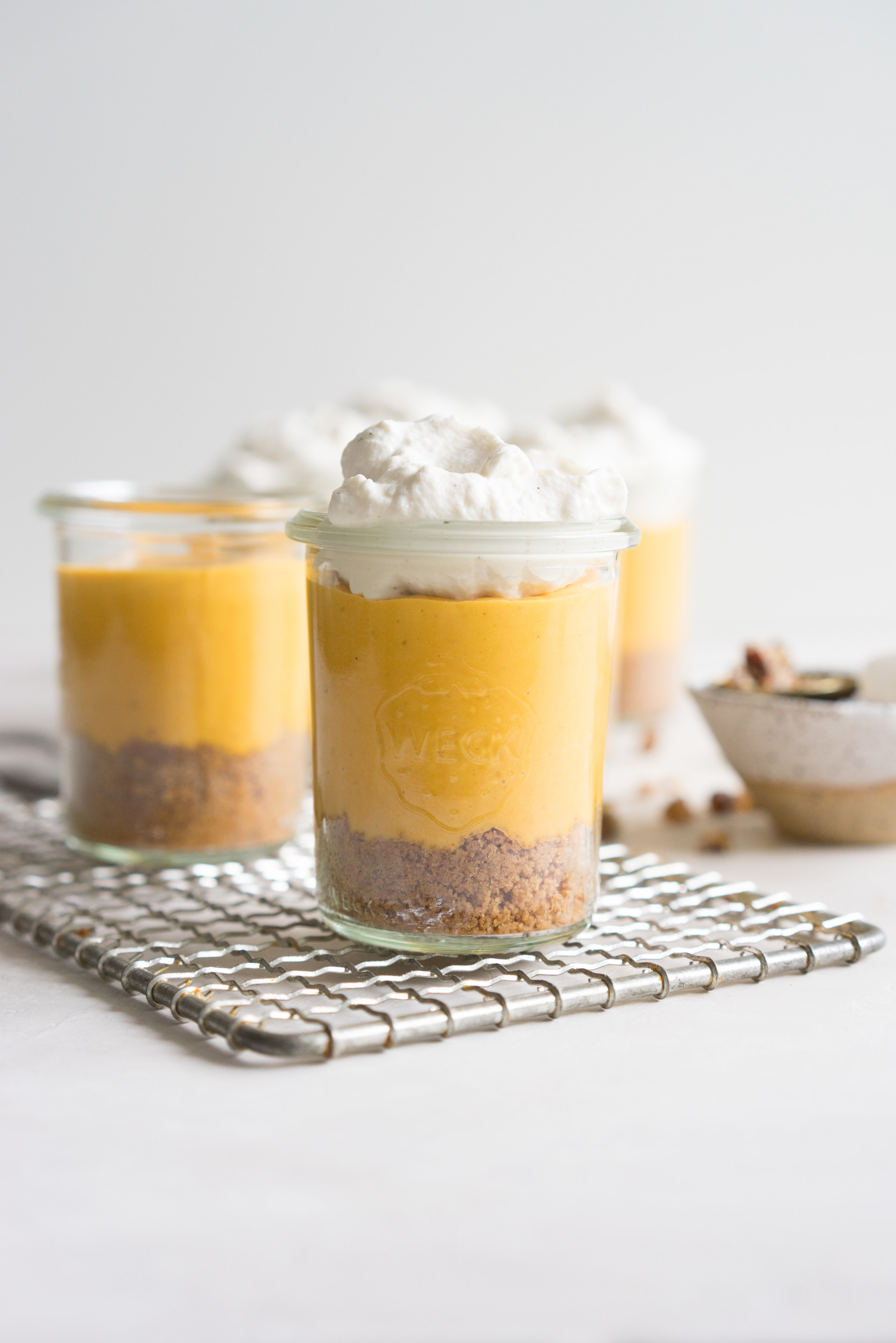 Spiced Shortbread and Pumpkin Custard Dessert Jars - spiced shortbread is topped with a brown sugar custard, then finished with a vanilla bean and maple whipped cream, and garnished with a pecan crunch.