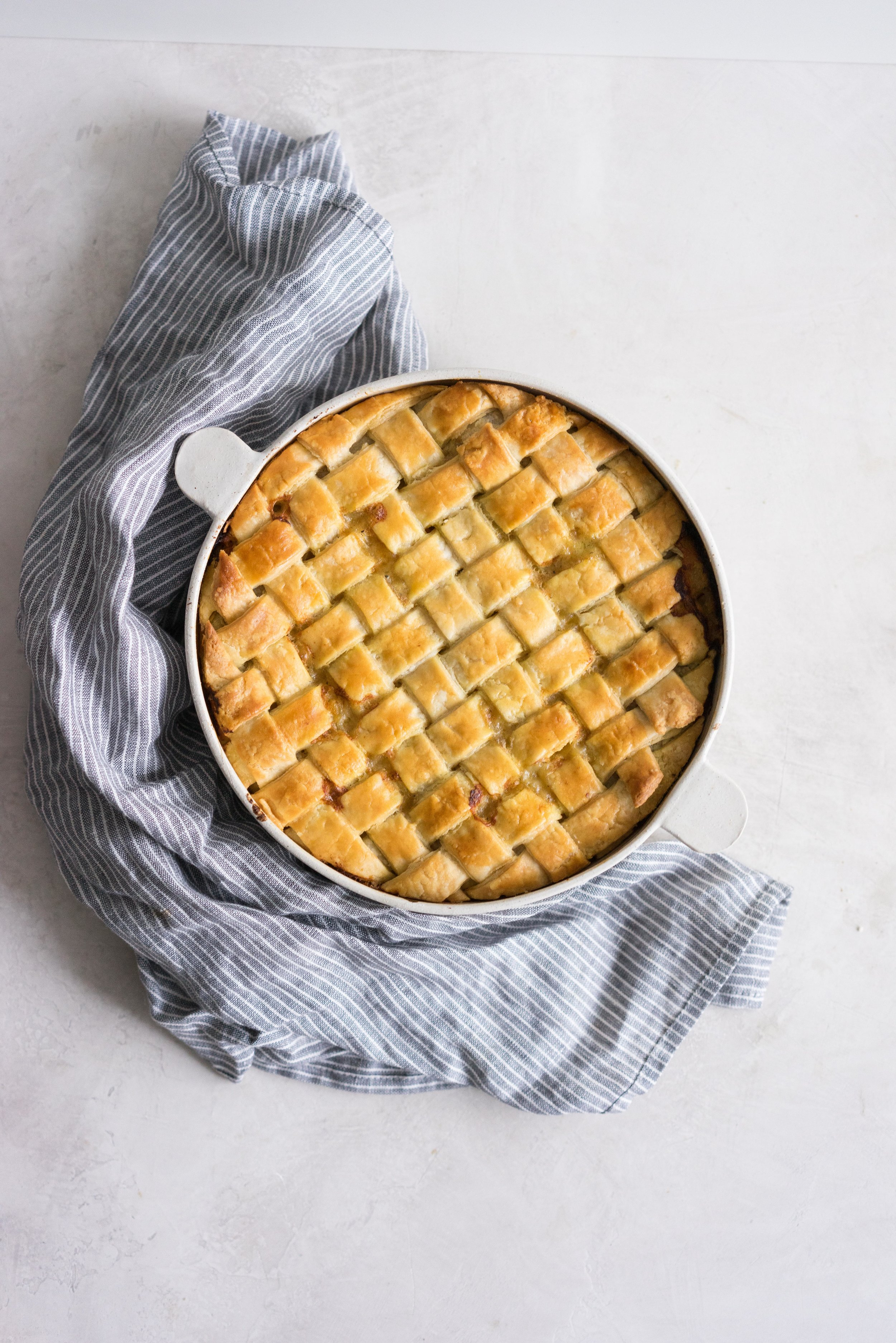 Chicken Pot Pie - a rich and flavoursome chicken, bacon, and vegetable mixture is topped with a flaky tender crust, and baked until deeply golden. The perfect winter comfort food