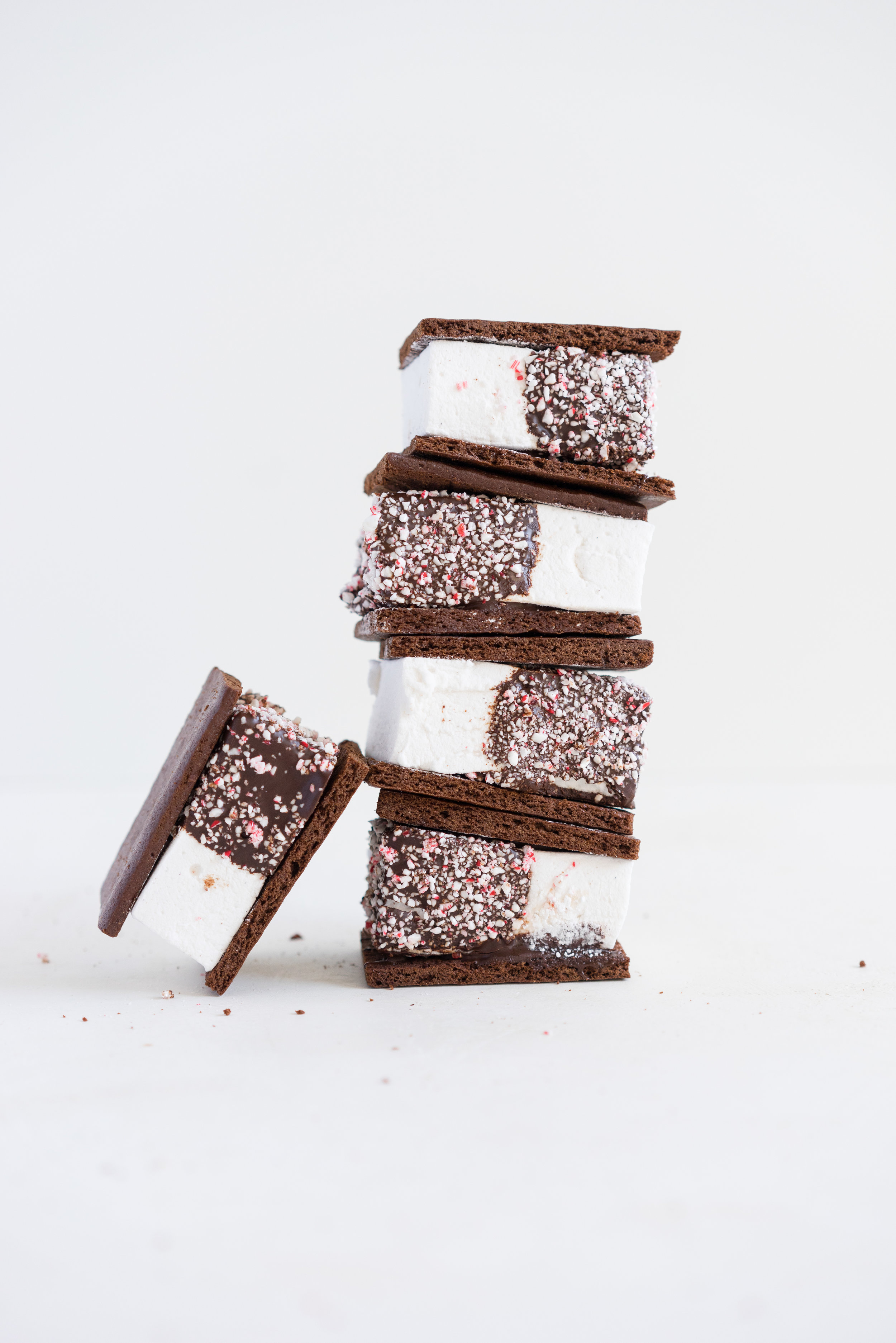 Peppermint S'mores with Chocolate Graham Crackers from Cloudy Kitchen. Puffy peppermint marshmallows are dipped in chocolate and rolled in candy canes, before being sandwiched between two chocolate graham crackers. A christmas twist on a holiday favourite