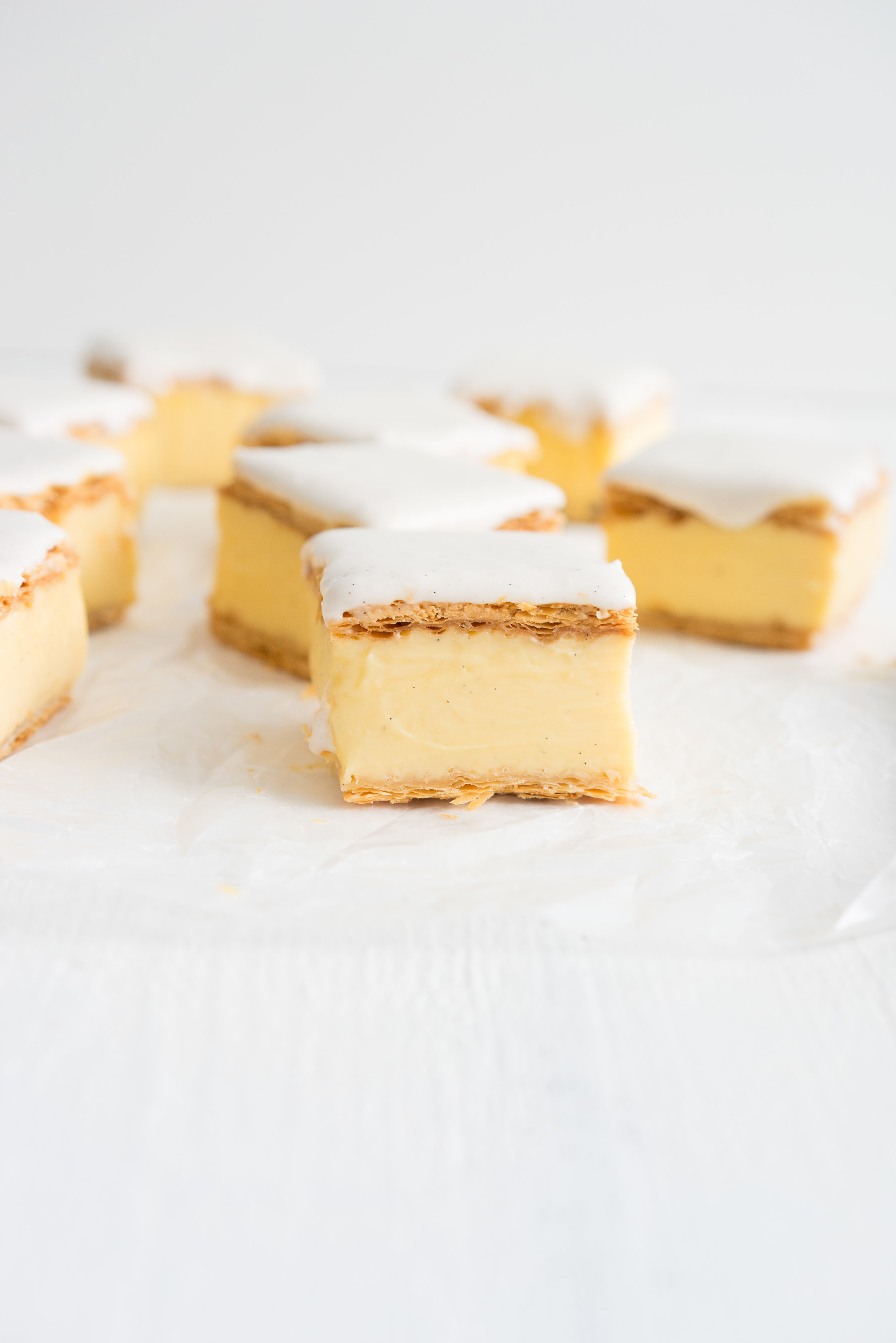 The perfect custard square - sheets of crisp flaky pastry sandwich a creamy rich vanilla bean custard. The whole thing is then loaded up with a vanilla bean glaze. This is a delicious take on a classic New Zealand childhood favourite.
