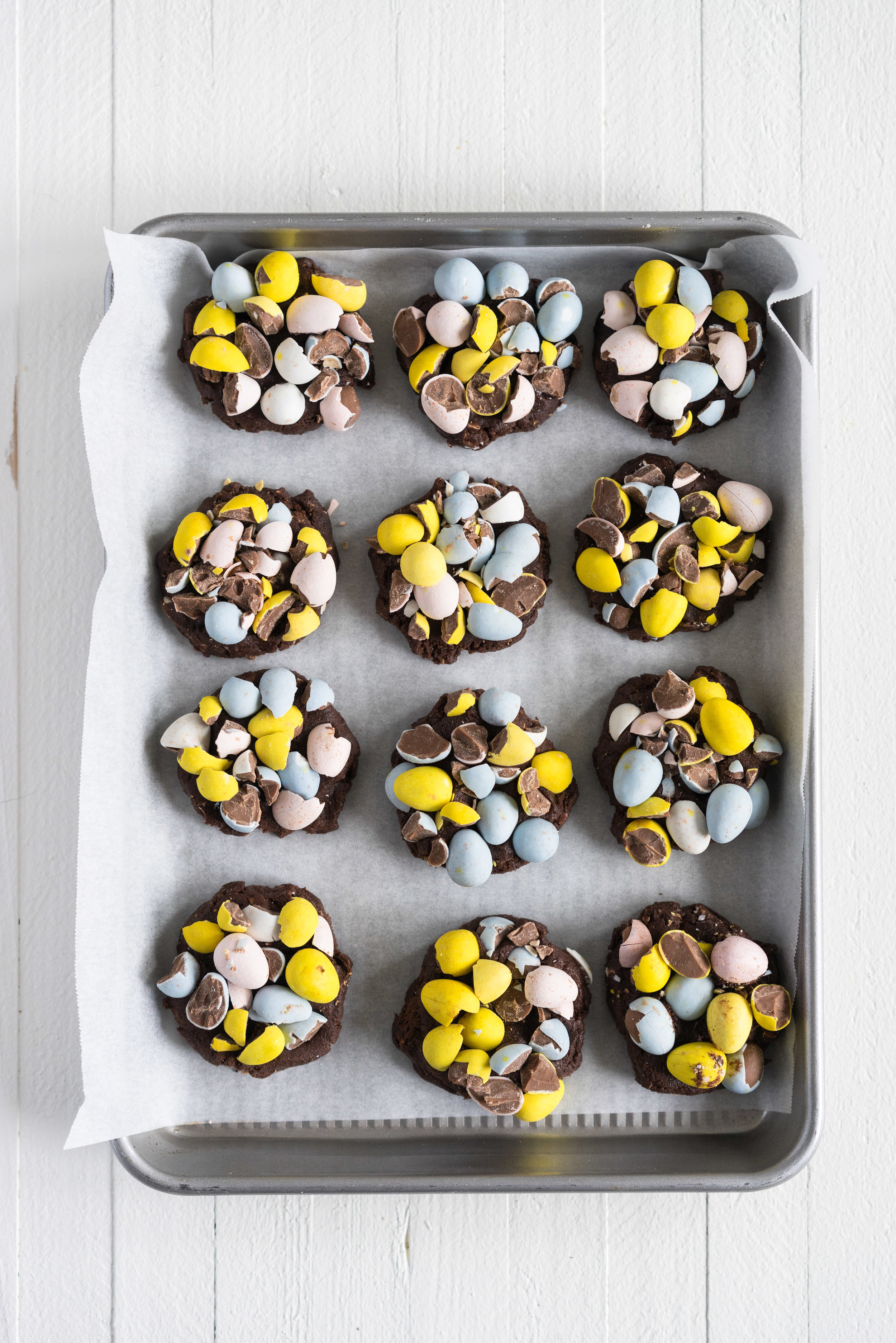 Milk Chocolate Mini Egg Cookies - the perfect addition to your easter baking schedule. These come together quickly, are super fun to make, and insanely delicious. Fudgy and chewy, chocolately and crispy, and loaded up with mini eggs.