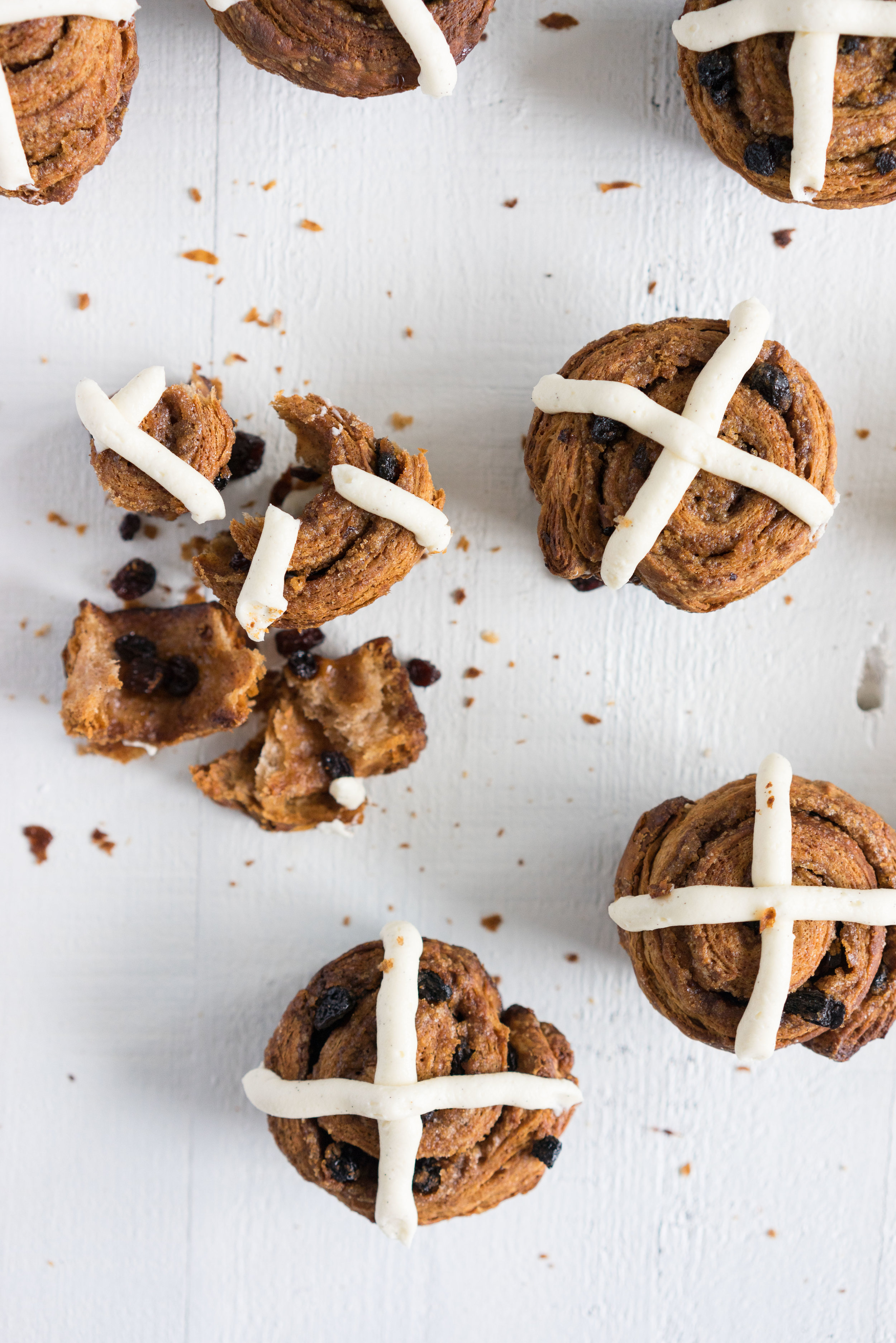 Hot Cross Bun Morning buns - a fancy twist on the traditional hot cross bun. A spiced dough is laminated with spiced butter, before being filled with a spiced sugar and dried fruit, and rolled up into a morning bun. The buns are finished with a mascarpone vanilla bean cross.