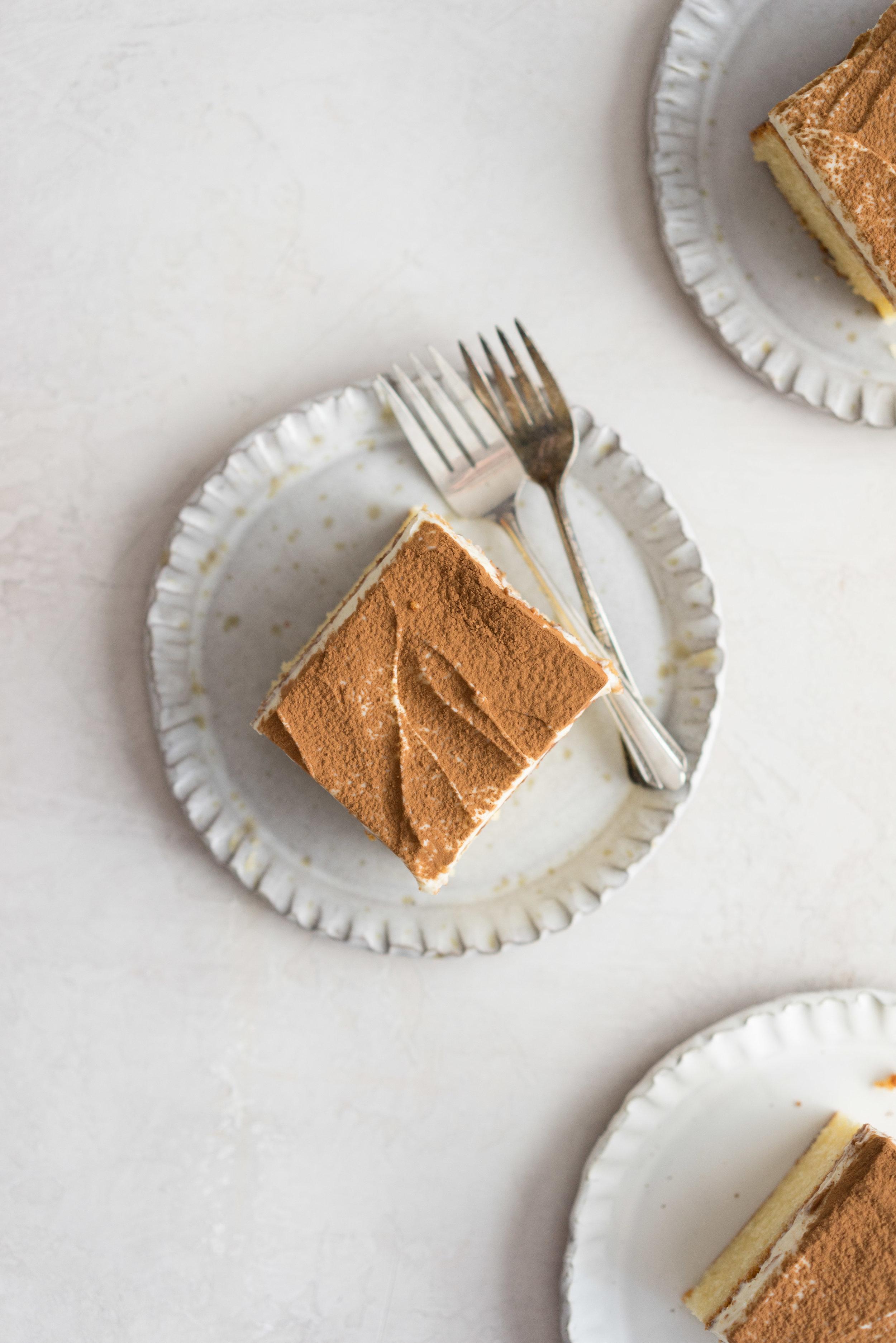 Tiramisu Sheet Cake - vanilla sheet cake, soaked in coffee, and finished with a creamy mascarpone frosting - www.cloudykitchen.com #sheetcake #tiramisu