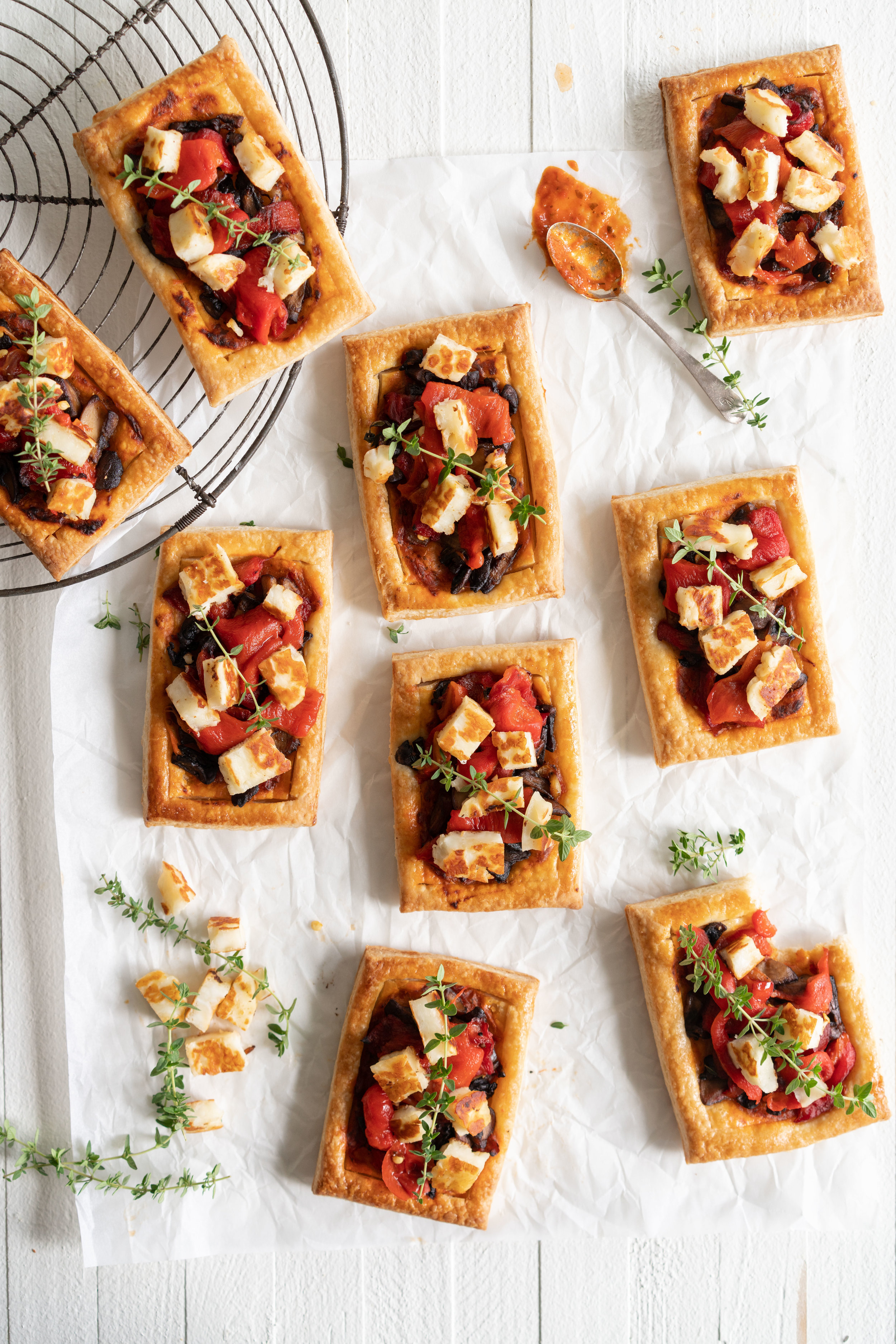 Chili Pesto, Mushroom, Roasted Red Pepper and Halloumi Tarts with Homemade Puff Pastry. The perfect appetizer or summer dinner - make these whatever size you want, they are bound to be a crowd pleaser! #mushroomtart #halloumi #chili #chilli #pesto #puffpastry #tart