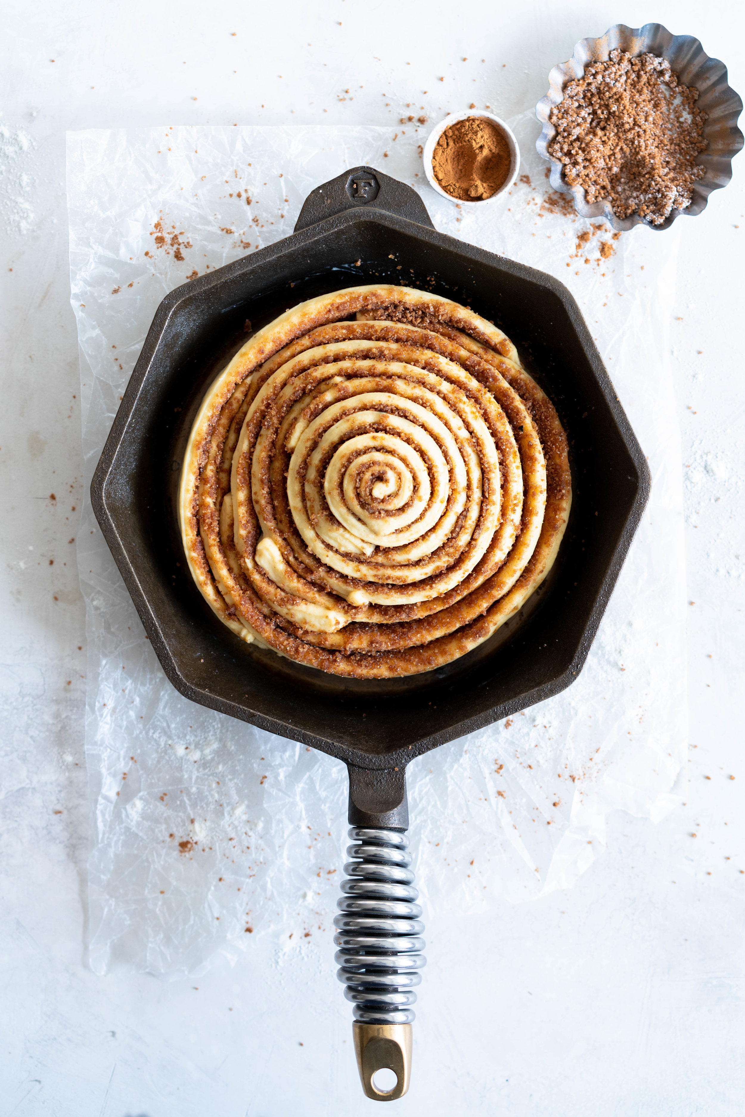 Giant Skillet Cinnamon Roll with Cream Cheese Icing - from Holiday and Celebration bread in five minutes a day. No knead brioche is covered in cinnamon sugar and rolled into a giant cinnamon roll - the most amazing twist on the traditional roll, and perfect for Christmas morning.
