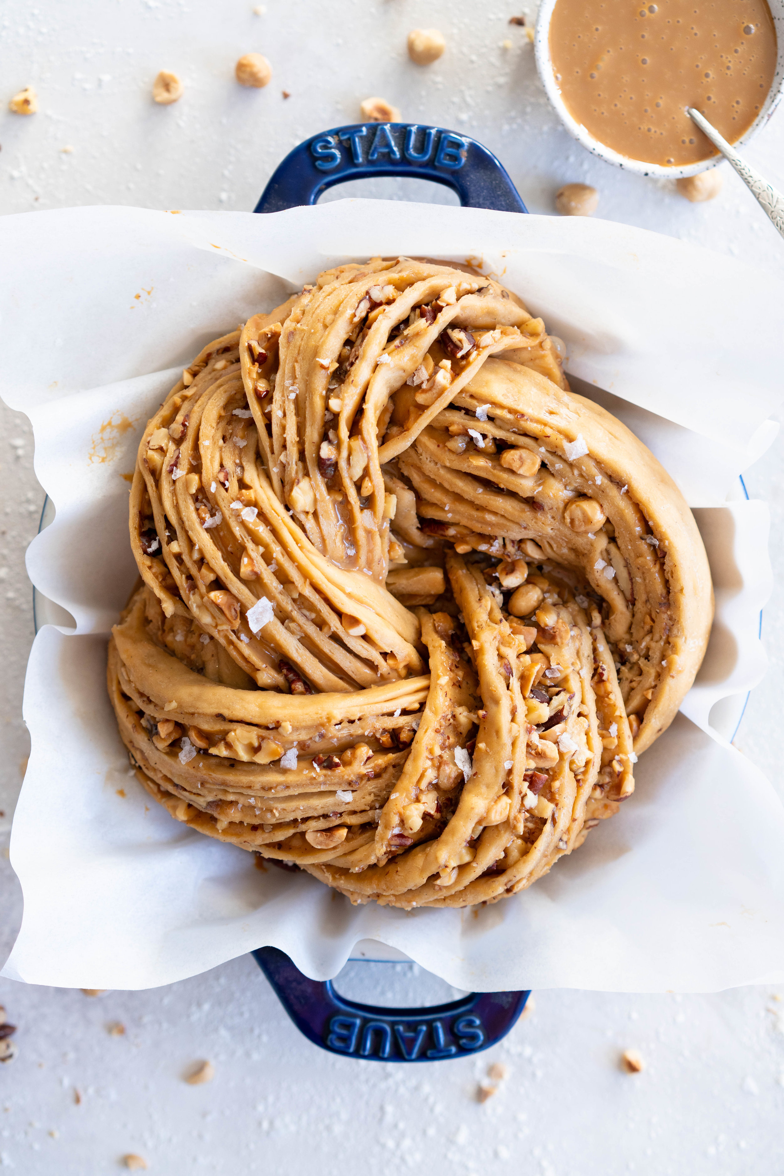 Brioche dough is spiked with vanilla bean and muscovado sugar, and spread with dulce de leche and sprinkled with mixed nuts. The finished knot is dusted with powdered sugar - the perfect christmas treat to feed a crowd.