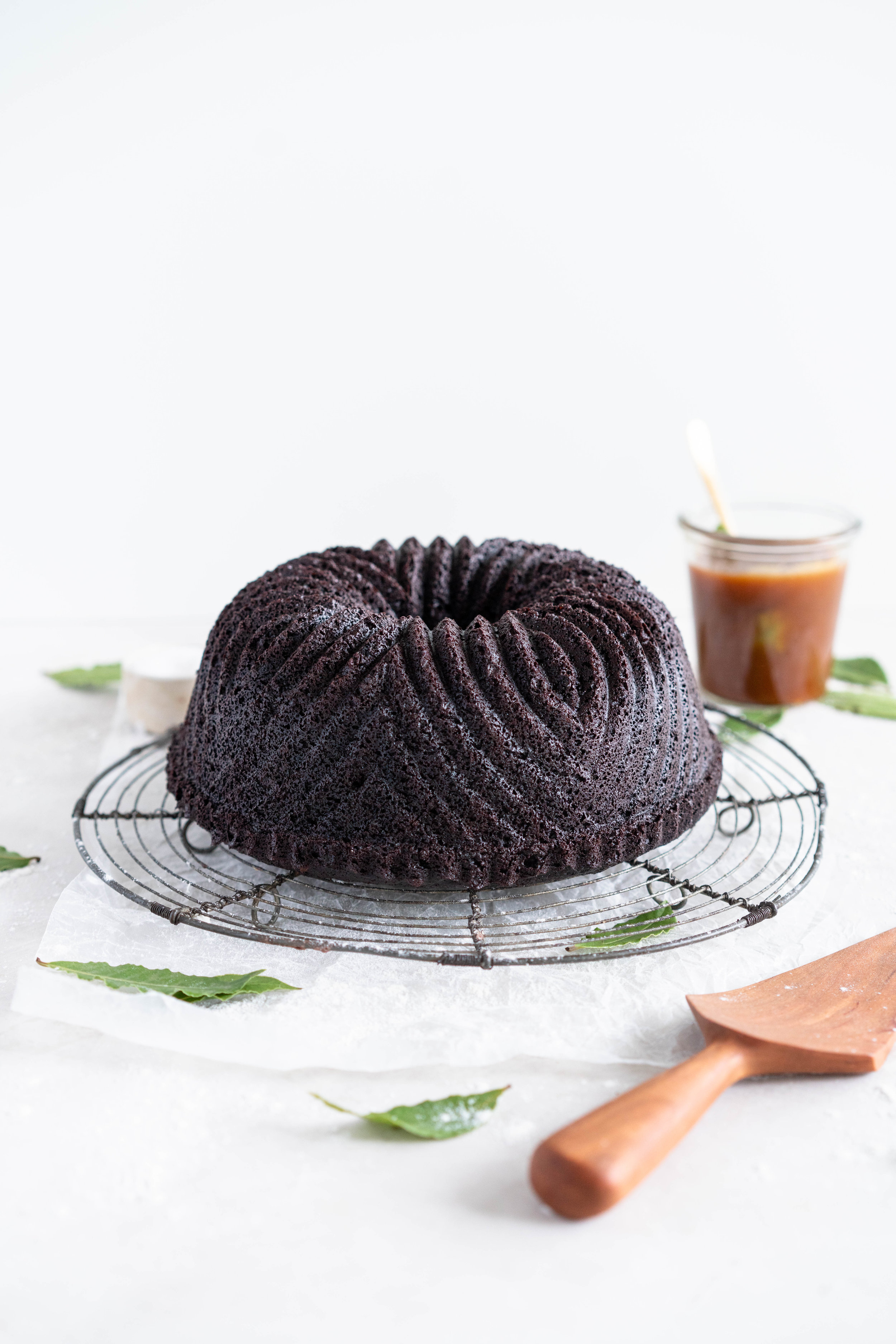 One Bowl Devil's food bundt cake with bay leaf caramel - a dense, moist chocolate bundt cake is loaded up with a lightly infused bay caramel. The cake is amazing alone, but with the caramel it is the perfect match. #devilsfoodcake #chocolatebundtcake #baycaramel