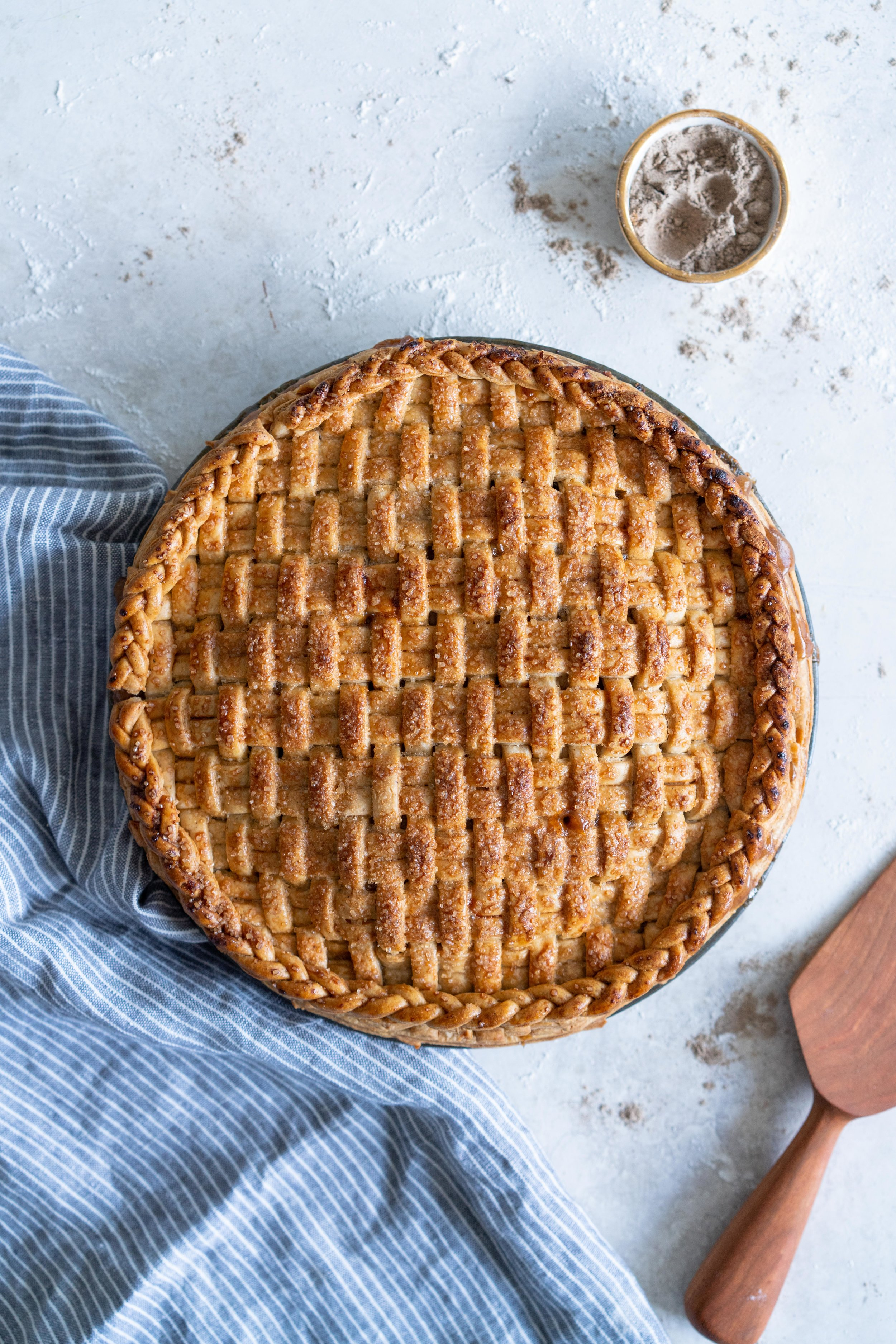 Apple and Cardamom Pie with Cardamom and Vanilla Bean Crust - a pie dough spiked with warming cardamom and fragrant vanilla bean encloses a spiced apple cardamom brown sugar filling. This variation on an apple pie is simple but delicious - it makes the perfect dessert or anytime treat. #cardamom #applepie