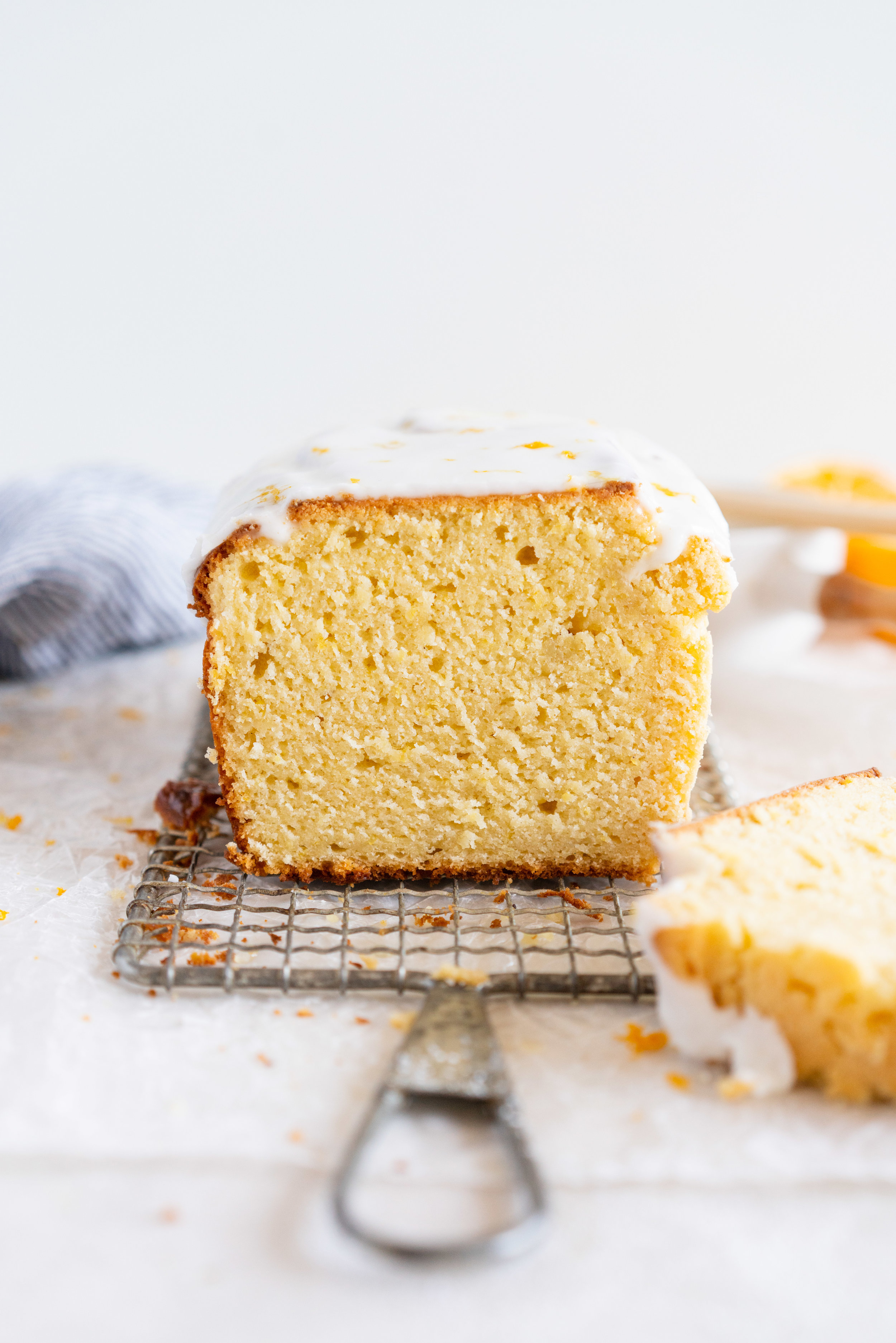 Lemon and Sour Cream Loaf Cake with Lemon Glaze. This stir together loaf cake has a beautifully tender crumb from the sour cream, and is brushed with a lemon syrup and finished with a lemon glaze for a perfect, punchy lemon flavour. This super easy baking project is perfect for a weekend, or for when you need a simple but delicious lemon cake recipe. #lemoncake #loafcake #lemonsourcream