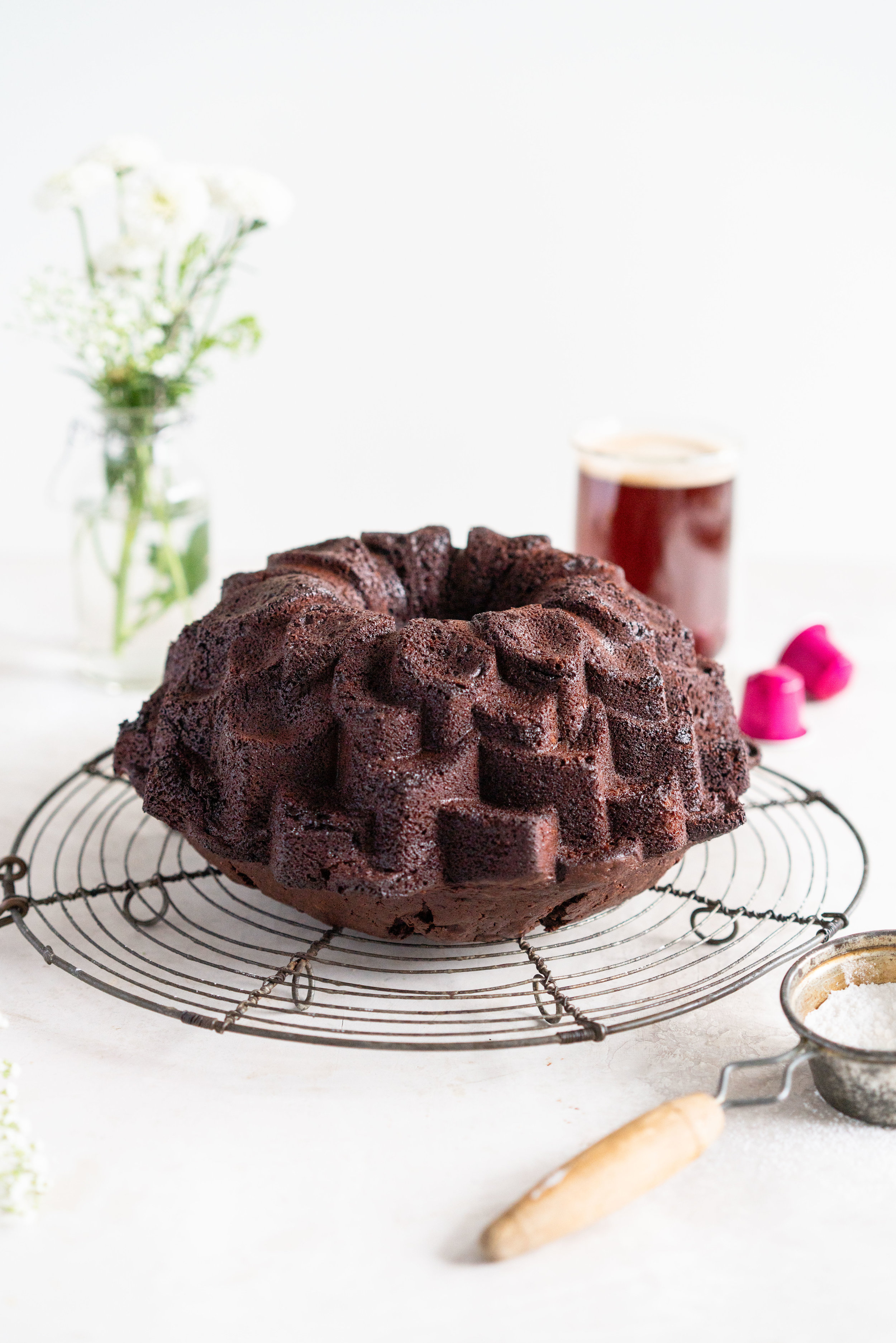 Nutella Chocolate Bundt Cake - this easy stir together bundt cake would be perfect for Mother's day or for any time that you need a sweet treat. It comes together super quickly, and is the perfect density thanks to the sour cream and nutella in the recipe. No mixer required - this one is a total crowd pleaser. #nutella #chocolatebundt #bundtcake