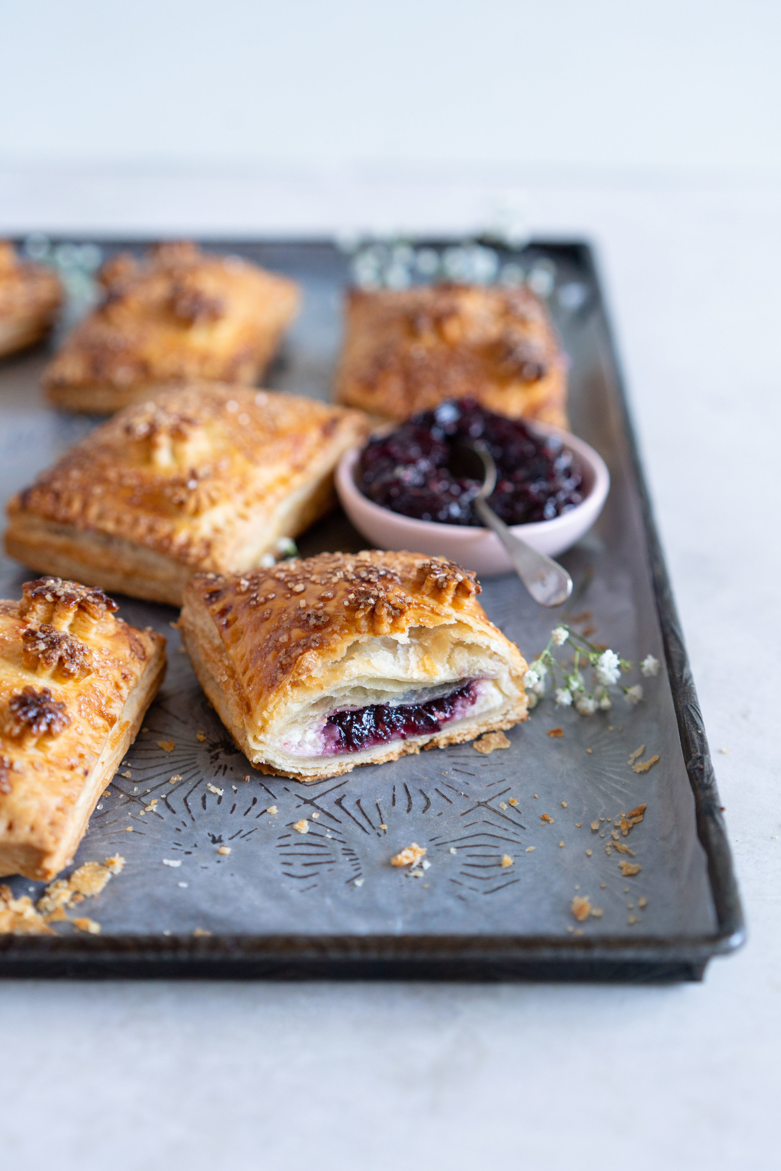 side on shot of mixed berry and cream cheese hand pies.jpg
