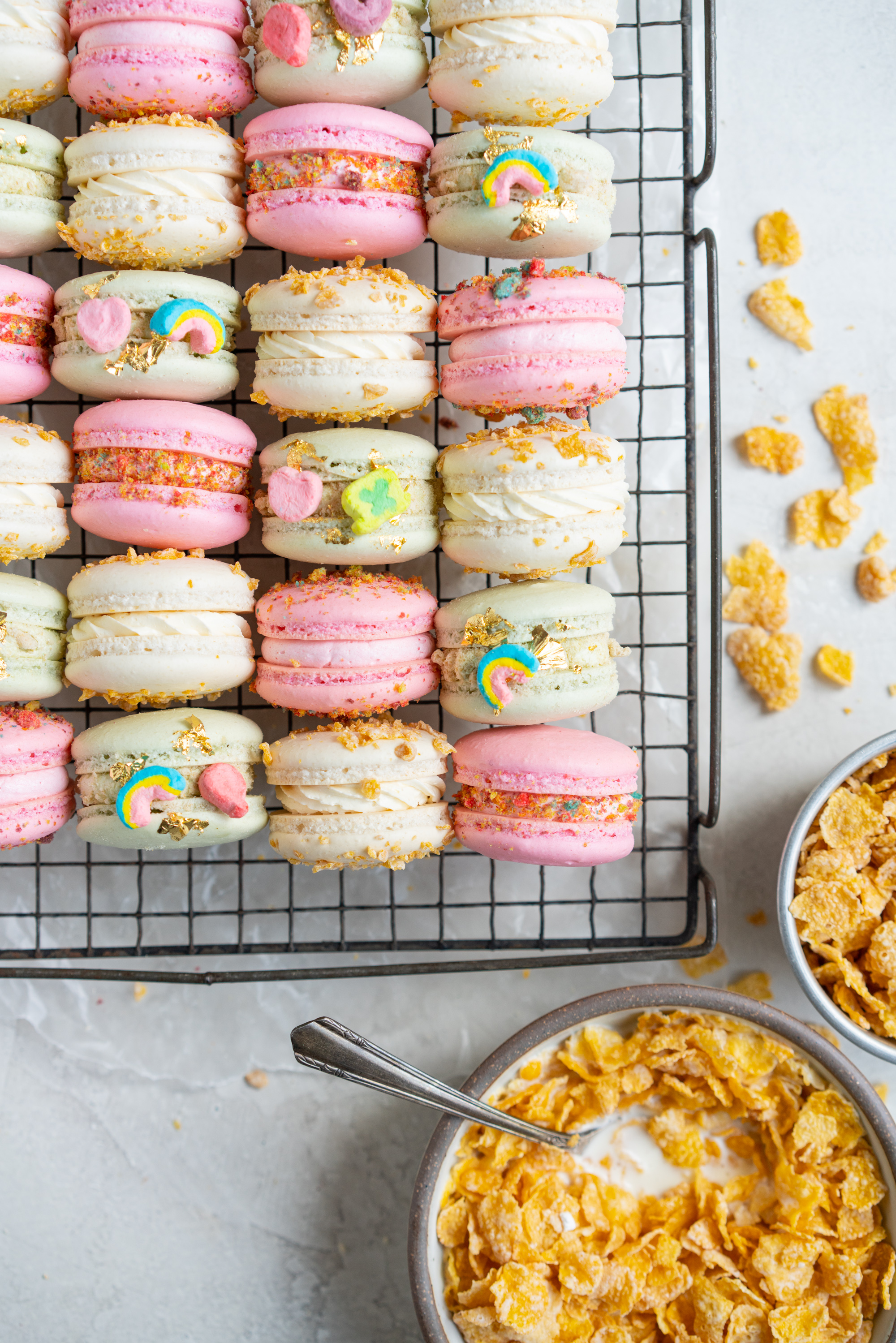 French Macarons with Cereal Milk German Buttercream. These Easy French Macarons are filled with a cereal infused german buttercream. They are an elevated version of your favourite childhood cereal. Frosted Flakes, Lucky Charms, Trix. #frenchmacarons #easymacarons #macaronrecipe