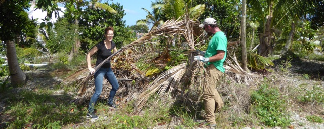 NAGB director, Amanda Coulson and Dr. Freid clearing the garden space.