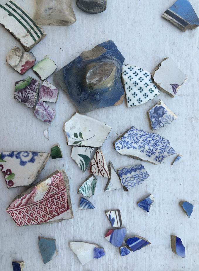 Shards of ceramics and pottery removed for inspection.