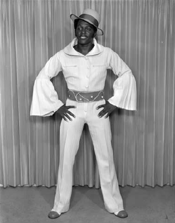 """Bahamian entertainer Leroy """"Smokey 007"""" Cleveland McKenzie photographed by Antoine Ferrier. (NAGB's """"Developing Blackness: Studio Photographs of 'Over the Hill' Nassau in the Independence Era"""")"""