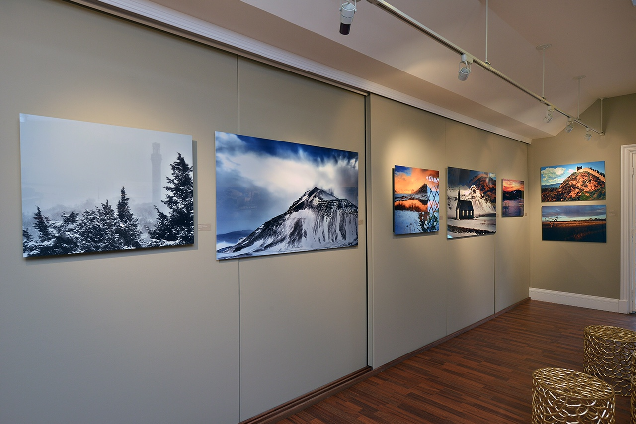 Installation shot of 'Nomad of the Golden Hour' featuring work by Greg Pesik