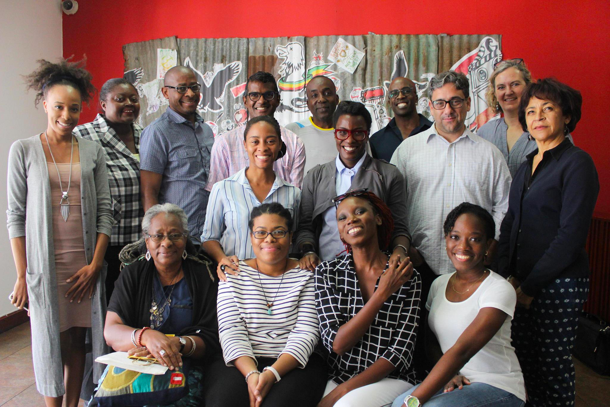 Creative Journalism Workshop partners, facilitators, and participants visit the National Gallery of Jamaica on Tuesday, January 10th. From Left (Back): Keisha Oliver, Joan Francis, Michael Bucknor, Andre Bagoo, Ian Jackson, O'Neil Lawrence and Claire Armitstead. From Left (Middle) Monique Barnett-Davidson, Melanie Archer, Gean Moreno, and Marina Salandy-Brown, From Left (Front) Icil Philips, Sasha Solomon, Denieve Manning and Kenesha Julius.