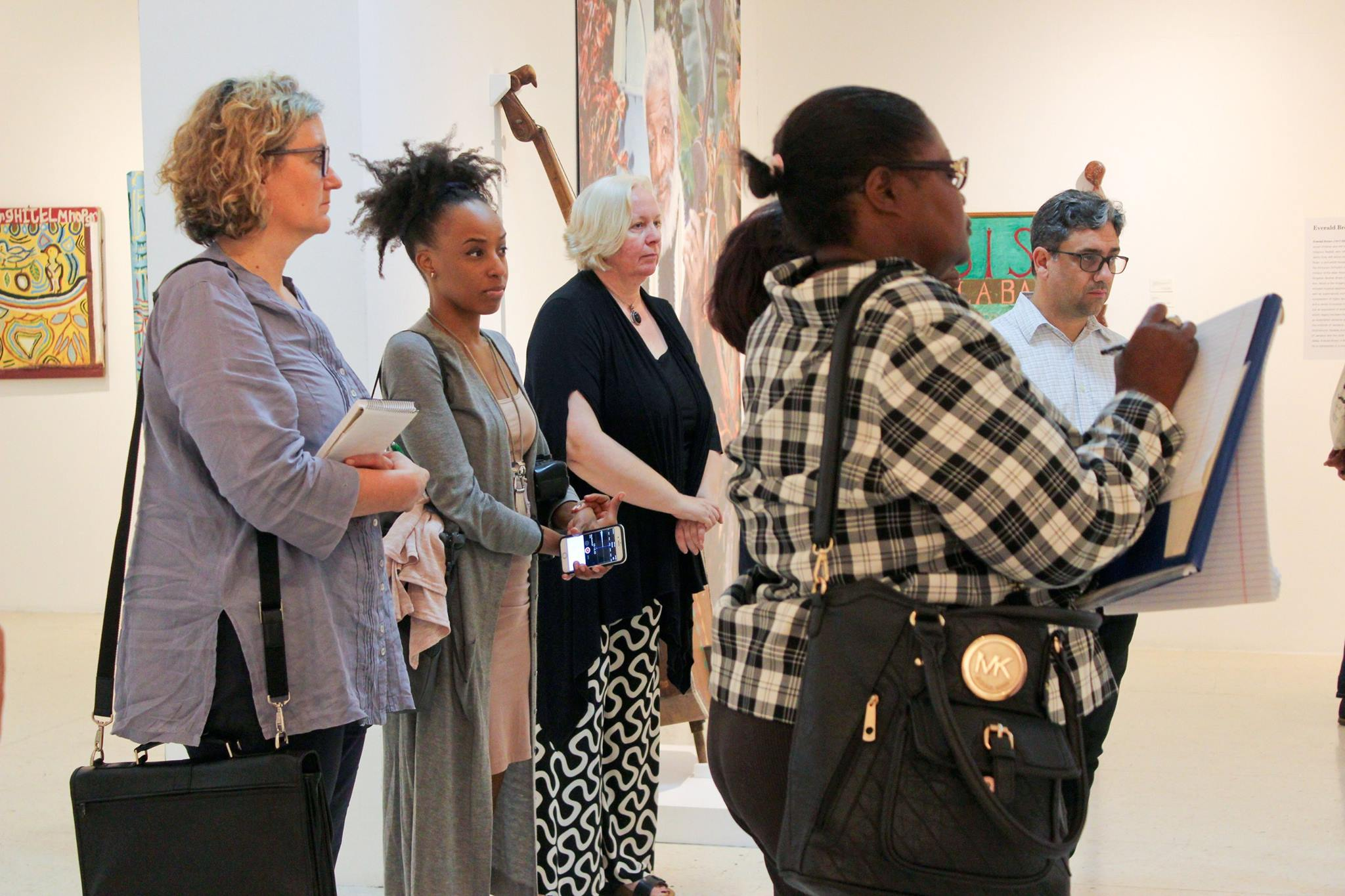 'Creative Journalism Workshop partners, facilitators, and participants visit the National Gallery of Jamaica. From Left: Claire Armitstead, Keisha Oliver, Dr. Veerle Poupeye, Joan Francis and Gean Moreno.