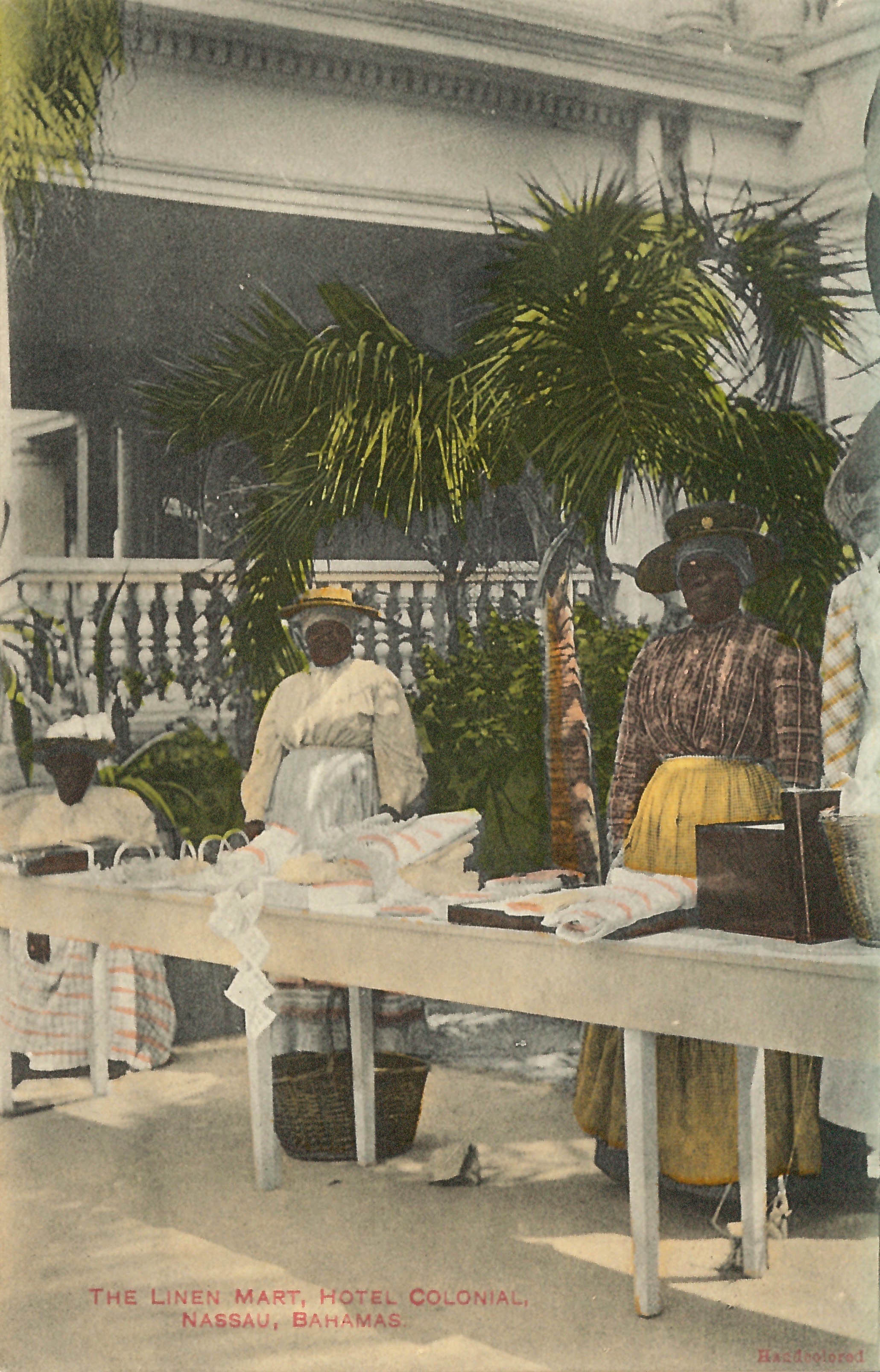 'The Linen Mart at Hotel Colonial'  (estimated c.1890-1930). Handcoloured colonial-era postcard by unknown artist. Image courtesy of the NAGB. Part of the National Collection.