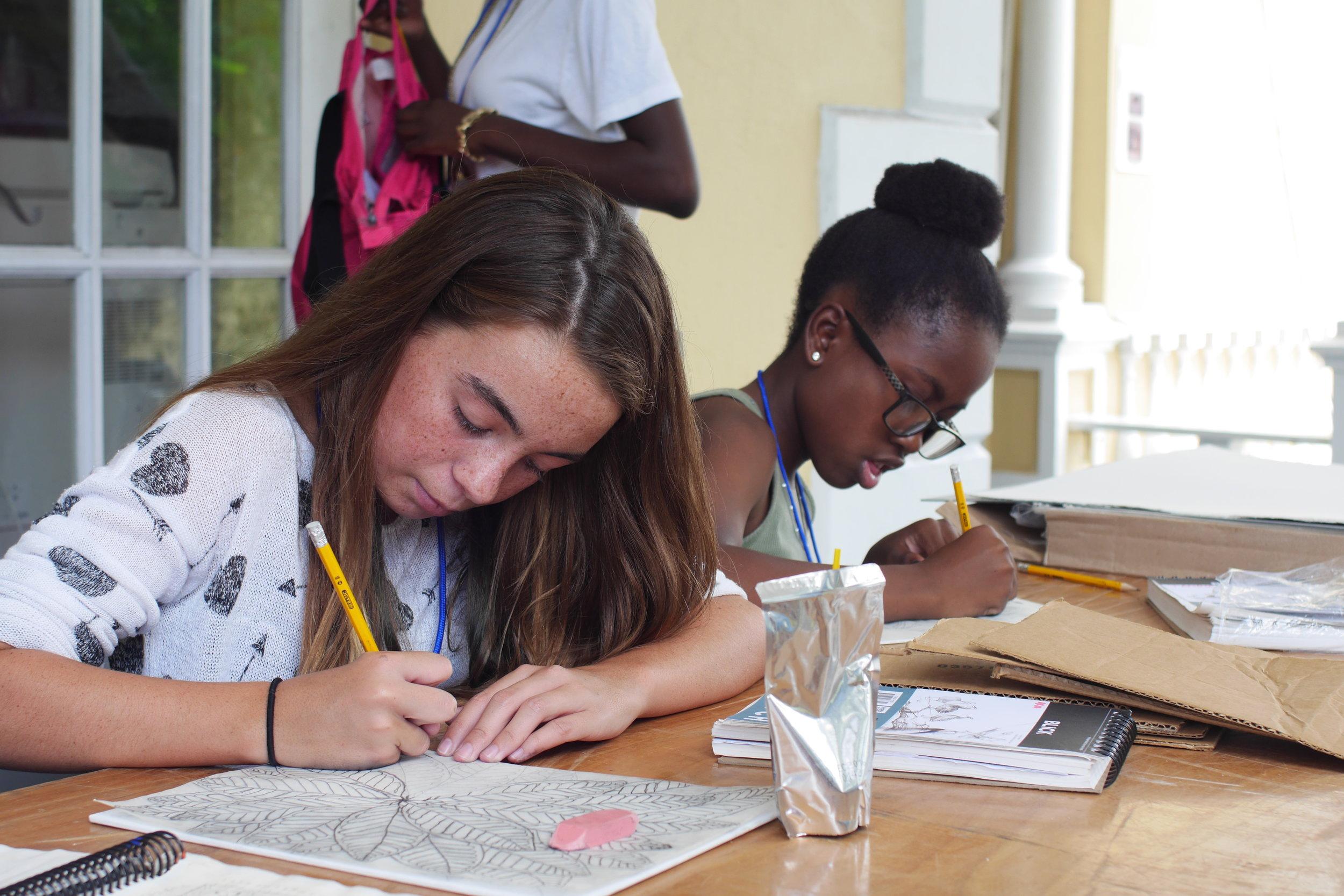 Eliana and Tamina working on their drawings at MMSAC 2016.