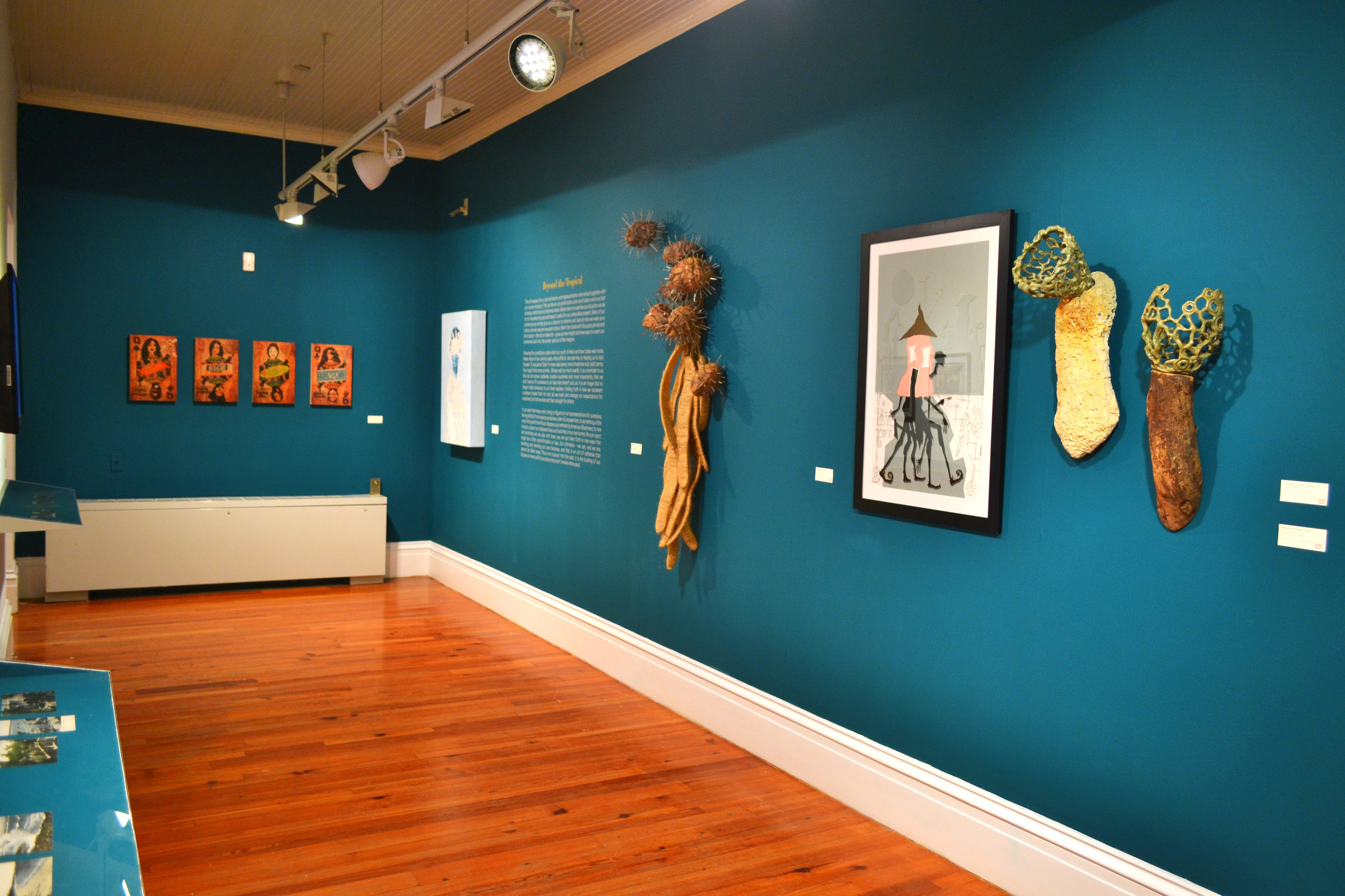"""Installation shot of Lavar Munroe's """"The Migrant"""" (2008) as seen in the current Permanent Exhibition, """"Revisiting An Eye For the Tropics""""."""