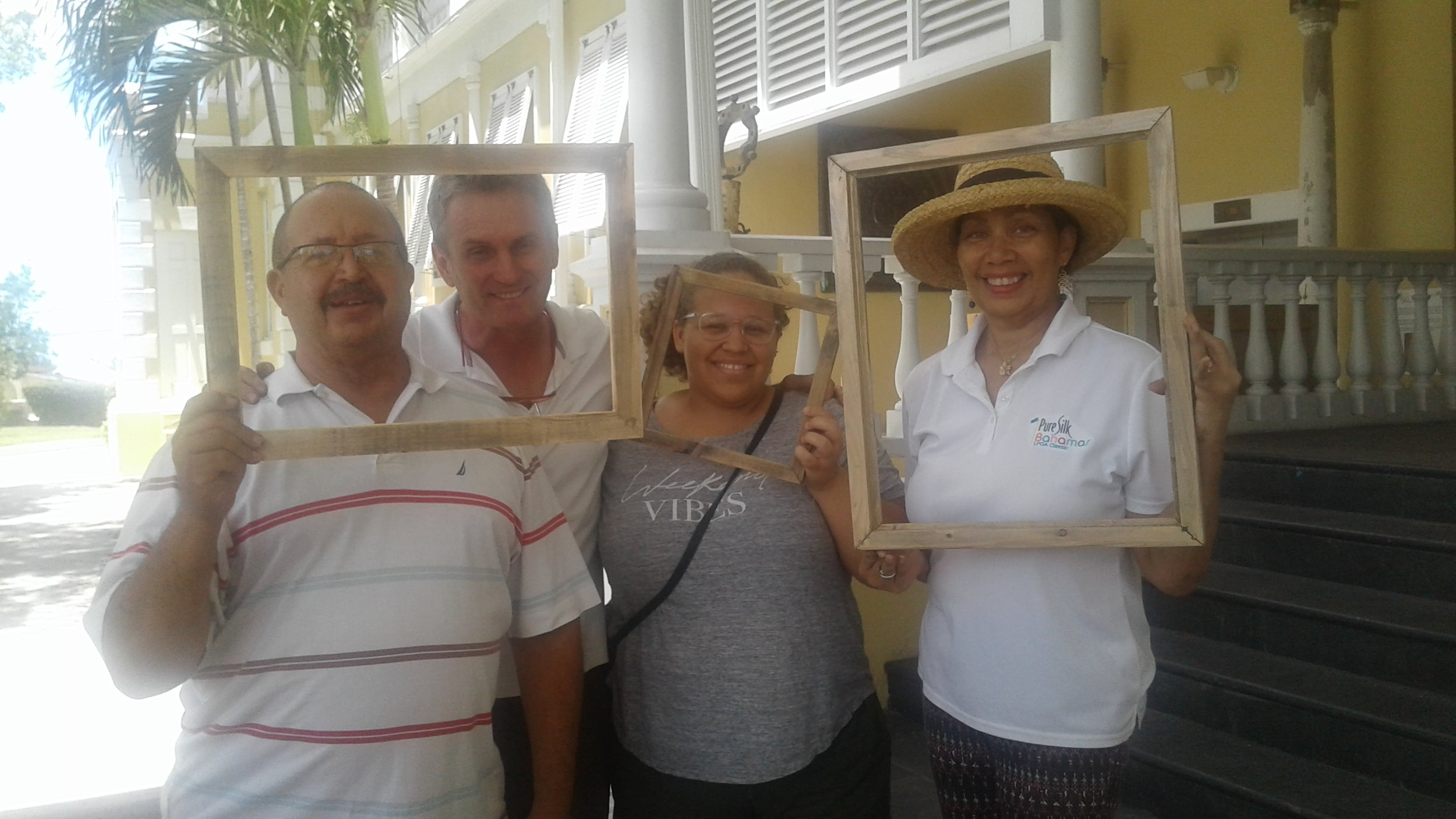 Artist Thierry Lamare and several participants proudly display their frames.
