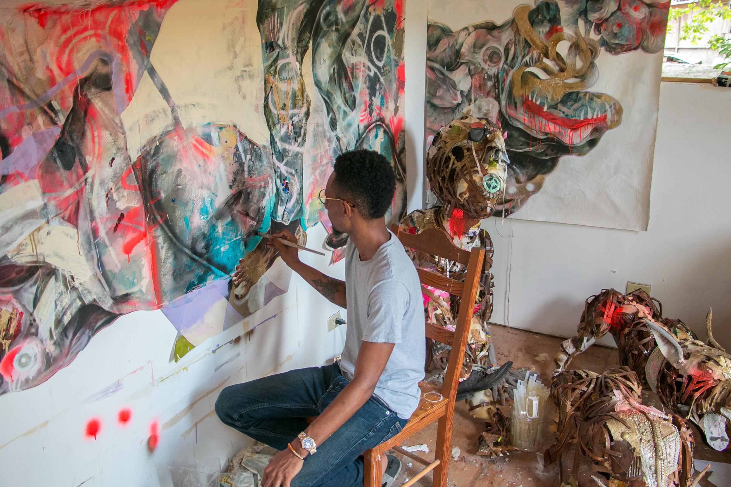 Lavar Munroe working in his studio on Milton Street, Nassau Bahamas.  (Photo by Keisha Oliver)