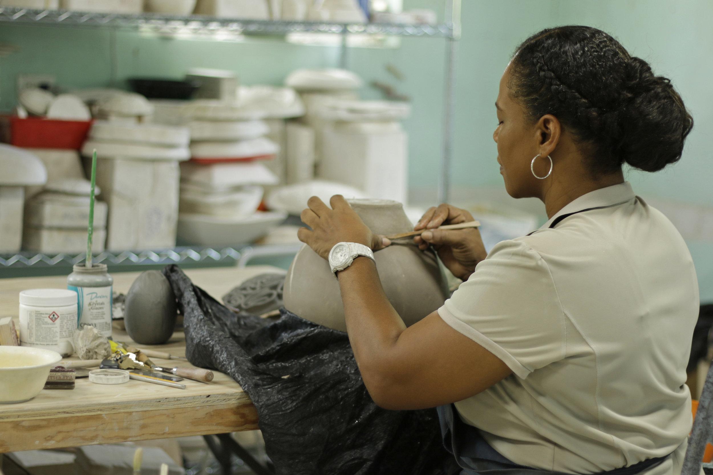 Jessica Colebrooke working in her ceramics studio (Jessica's Tileworks Studio in Gleniston Park, Nassau, The Bahamas. (Photo by Keisha Oliver)