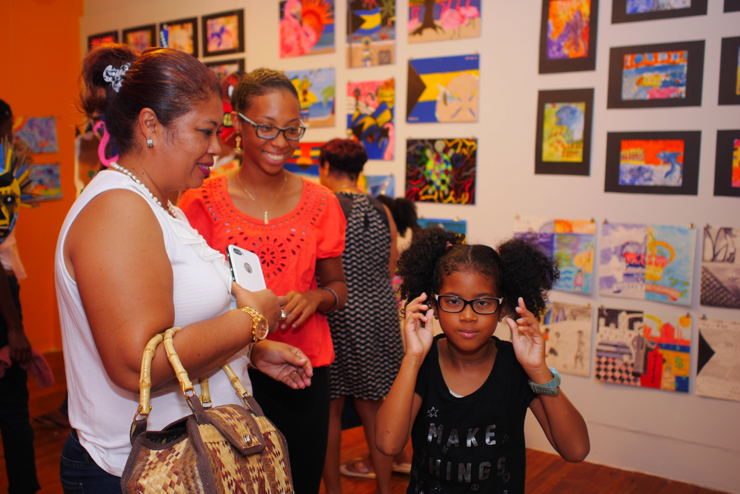 Summer camp participant with her mother and grandmother at the opening of the ongoing NAGB Mixed Media Art Summer Camp Exhibition 2017 , A Journey Through Time: Telling Our Story with Art  on view at the gallery through the end of the month. Image courtesy of the NAGB.