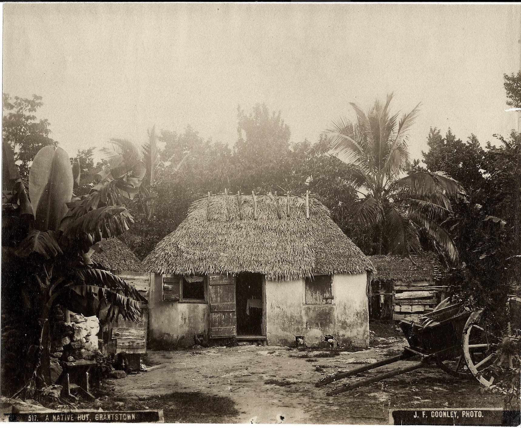 """""""A Native African Hut"""" (ca.1870 - 1900), Jacob Frank Coonley, albumen print, 7 x 8. Part of the National Collection, previously owned by R. Brent Malone. This photograph was originally printed in """"Stark's History and Guide to the Bahama Islands"""" in 1900."""