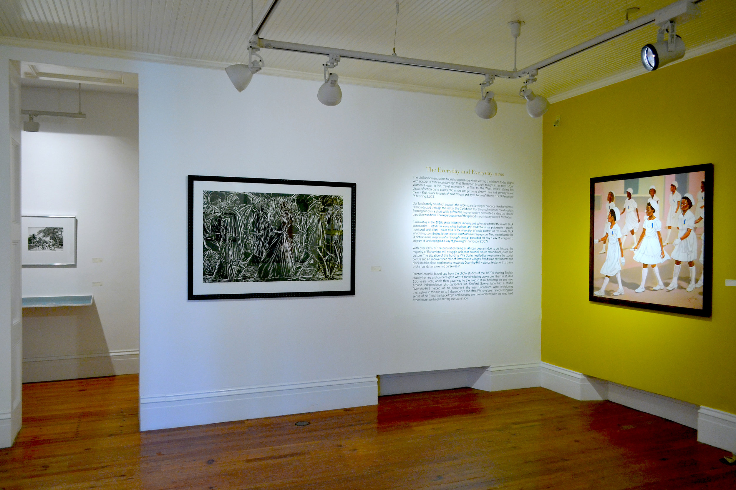 """Installation view of """"The Immigrants No.3"""" (c1990) by Maxwell Taylor, part of the National Collection as seen in the current Permanent Exhibition, """"Revisiting An Eye For The Tropics""""."""