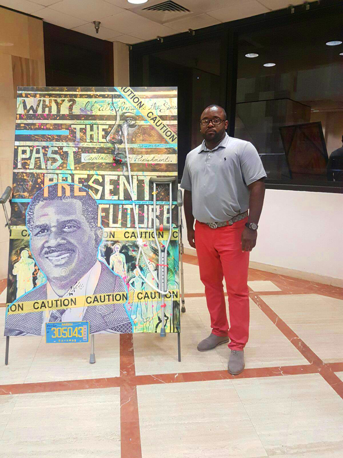 The Central Bank of The Bahamas 34th Annual Art Competition Open Category Prize Winner, Ryan Turnquest with his mixed media piece 'The People Have Spoken""
