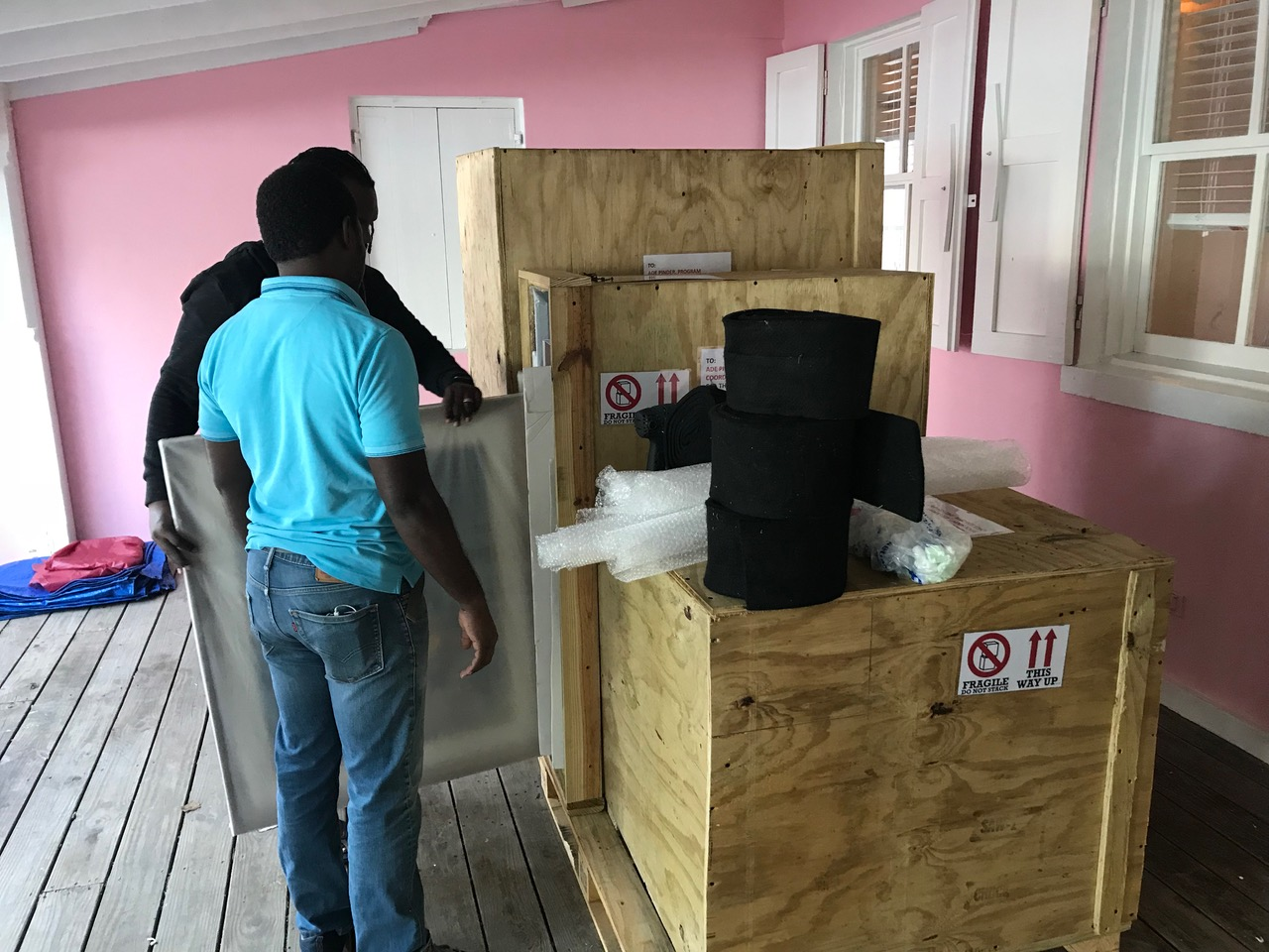 """Team NAGB preparing to and installing """"TRANS: A Migration of Identity"""" at The South Eleuthera Mission, Rock Sound Eleuthera."""