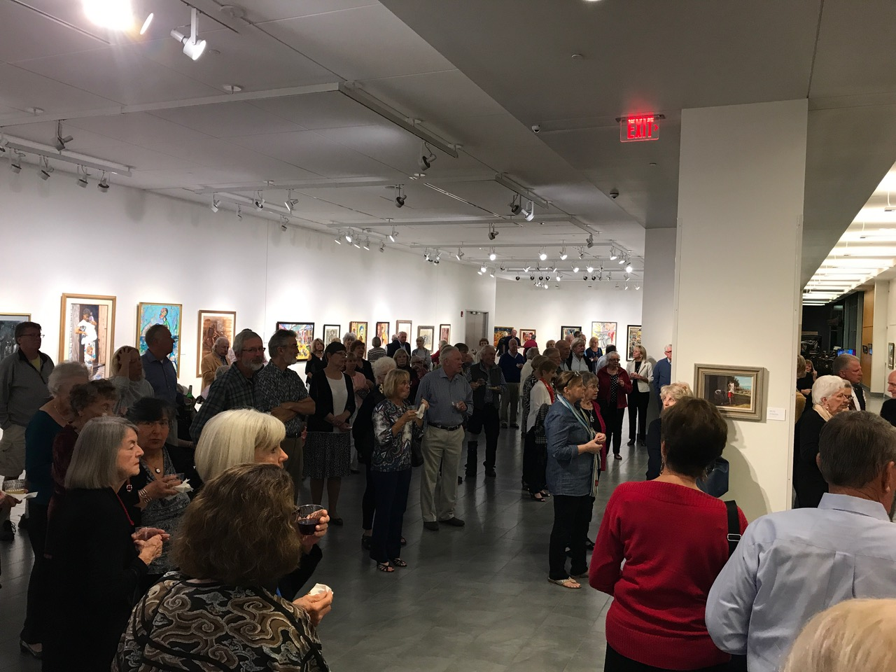 "Guests at the Elliott Museum enjoying the opening reception of ""Celebration: Art of The Bahamas."""