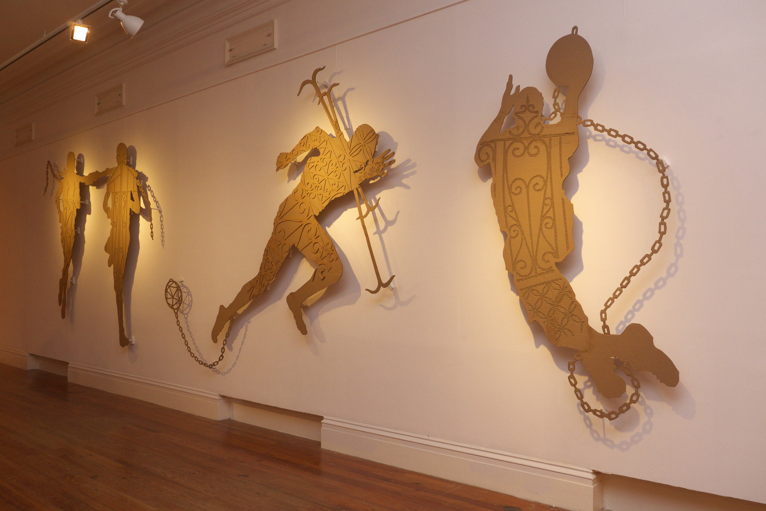 """John Beadle's """"Higher Goals"""" (2014) shown as part of the 7th National Exhibition. His work for """"We Suffer To Remain"""" further investigates and expands these cardboard figures of Bahamian and Caribbean society."""
