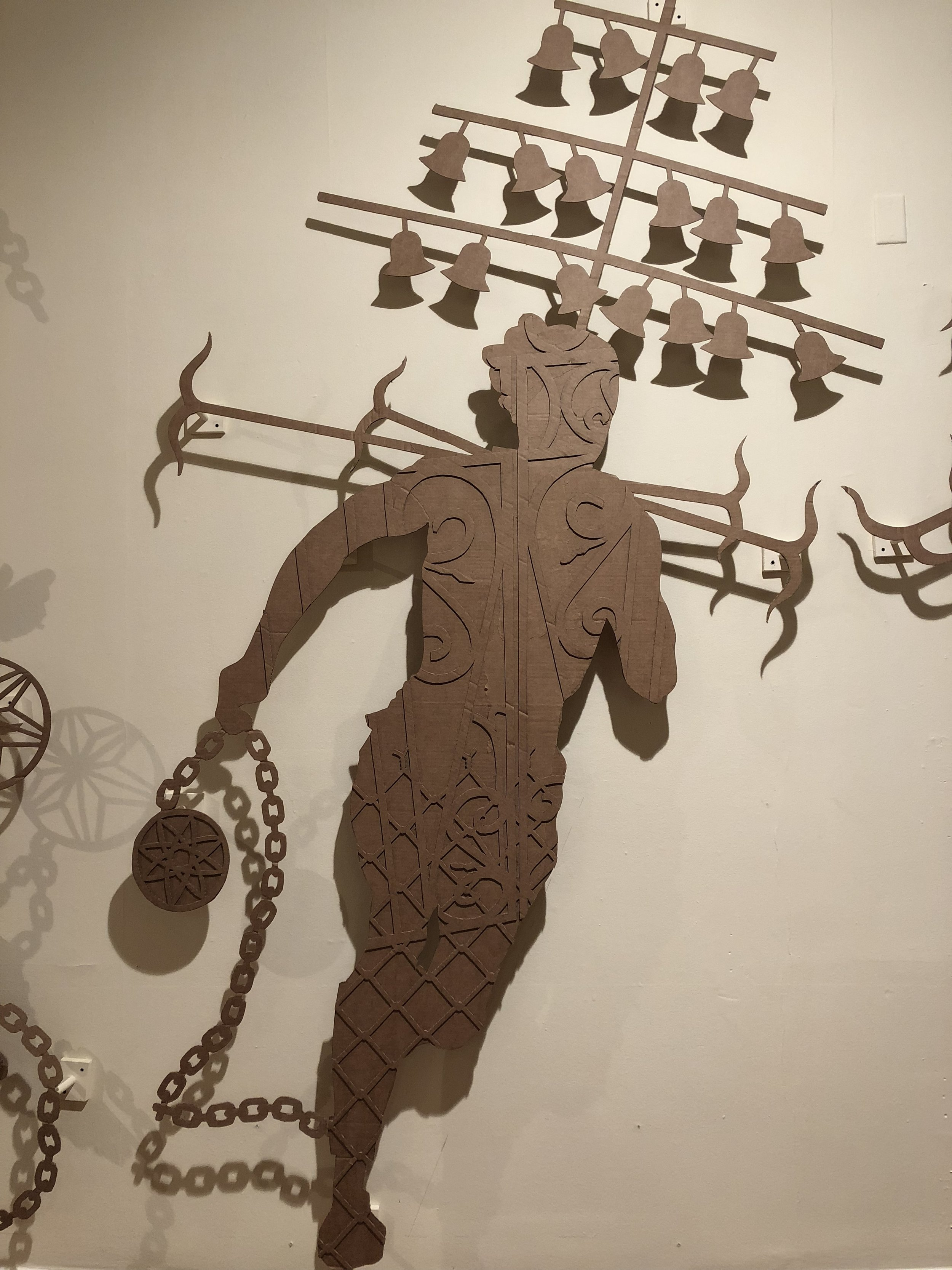 """Detail of John Beadle's """"Cuffed: held in check"""" (2018), a series of corrugated cardboard cutouts investigating representation and stereotyping around blackness as it relates to the legacies of the Atlantic slave trade."""