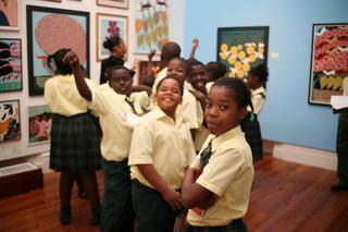 Students enjoying an NAGB workshop exploring the works of Amos Ferguson.