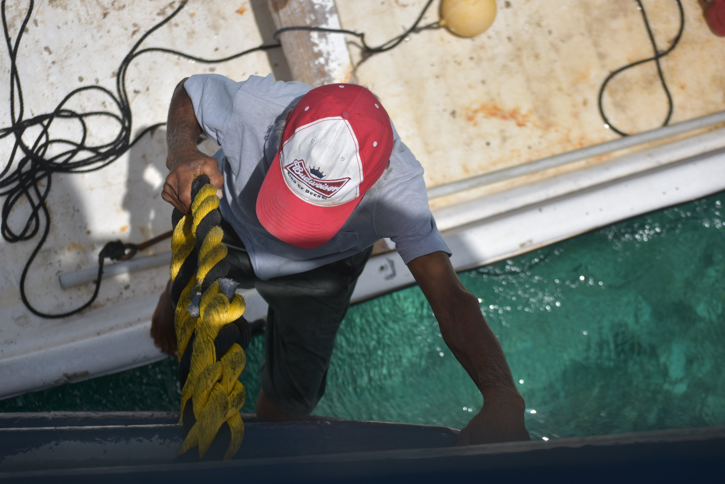 Edward Lockhart climbing aboard the MV Captain C.