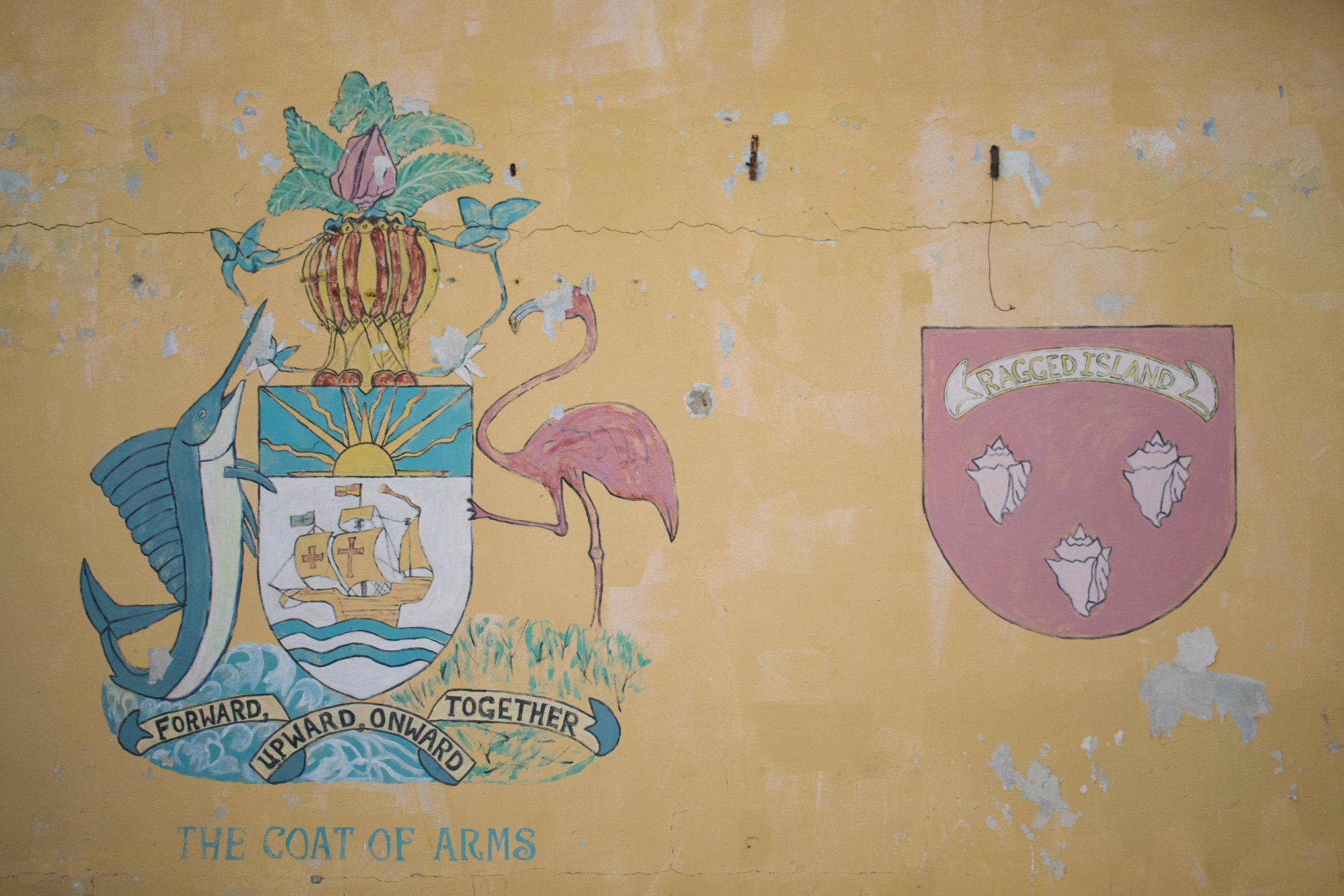 Coat of Arms on a destroyed and abandoned building on Ragged Island.