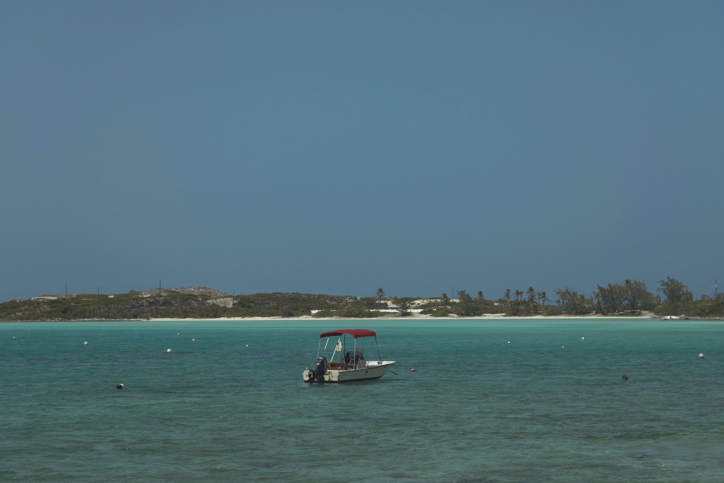 A lone fishing boat tied down off the coast of Exuma. Photo by Ethan Knowles.