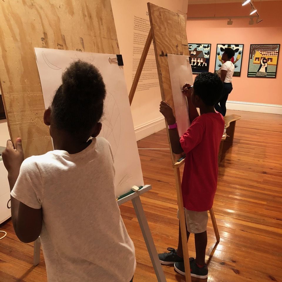 1.     Two friends drawing in the galleries of our Permanent Exhibition.