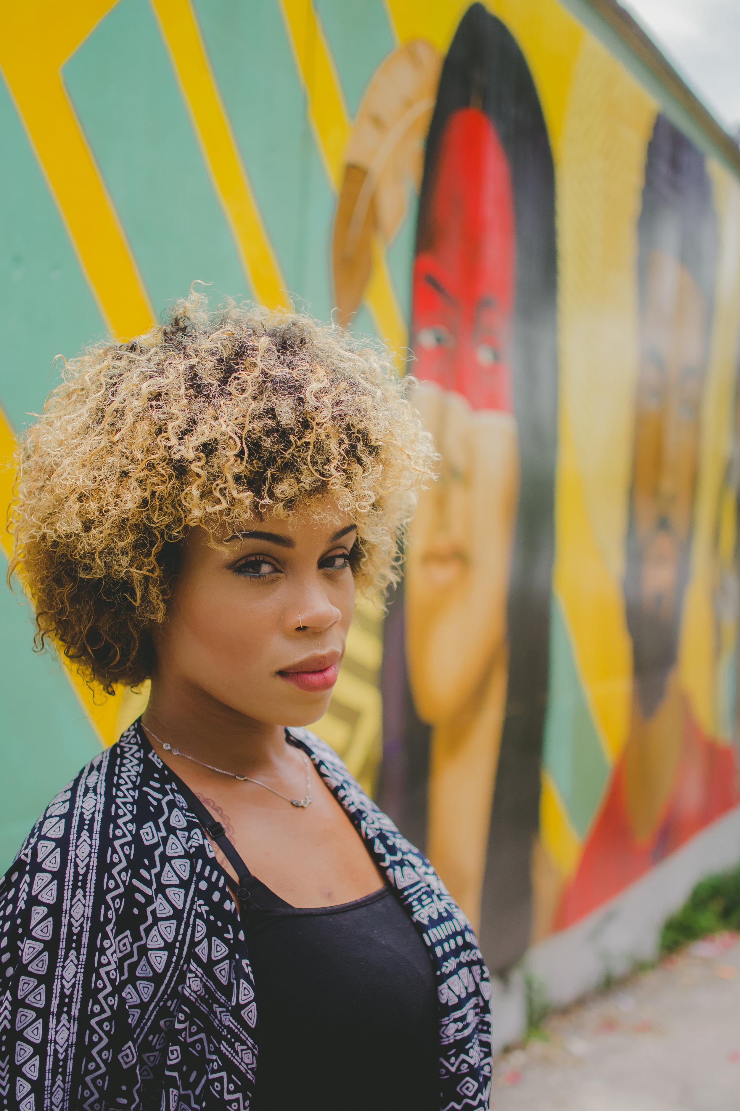 "Darchell Henderson, the artist for ""Legacy"" (2018) on Hospital Lane."