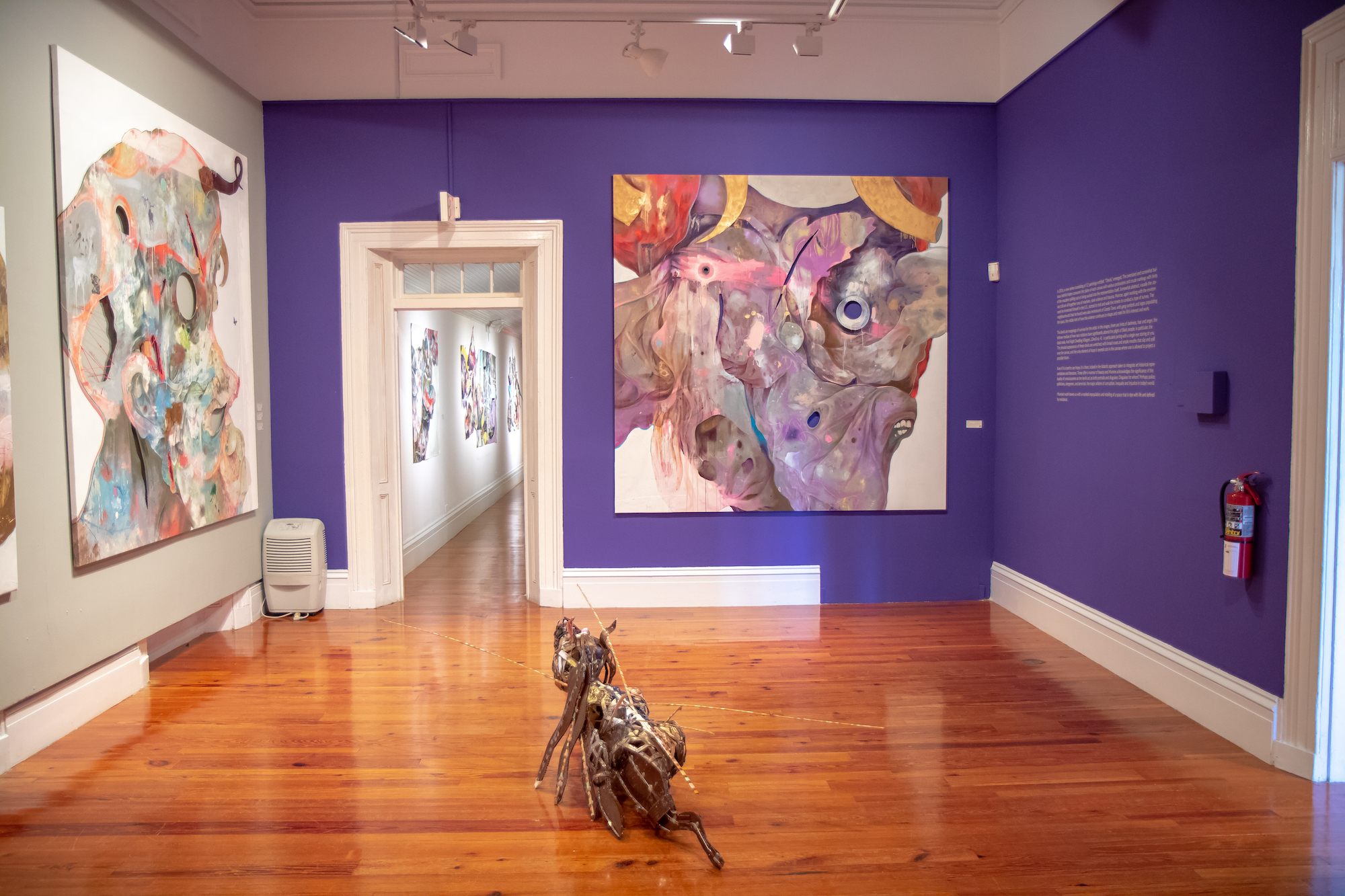 """Lavar Munroe's """"Son of the Soil"""" installation shot of the North Eastern room with works from the """"Devils"""" and """"Gundogs"""" series. Image by Jackson Petit."""